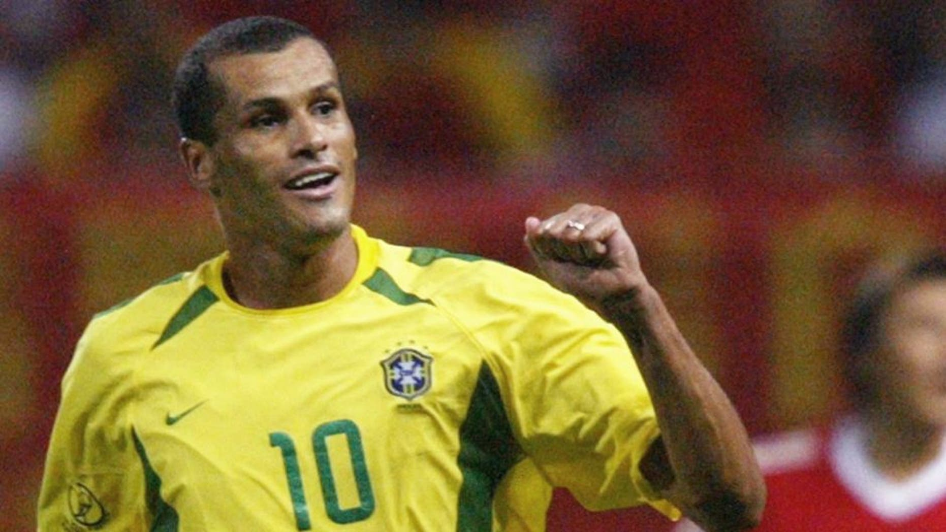 SEOGWIPO, REPUBLIC OF KOREA: Brazil's Rivaldo (L) celebrates after scoring in the 31st minute as China's Li Weifeng (R) looks on, 08 June 2002 at the Jeju World Cup Stadium in Seogwipo, during first round Group C action between Brazil and China in the 2002 FIFA World Cup Korea/Japan. AFP PHOTO/ANTONIO SCORZA (Photo credit should read ANTONIO SCORZA/AFP/Getty Images)