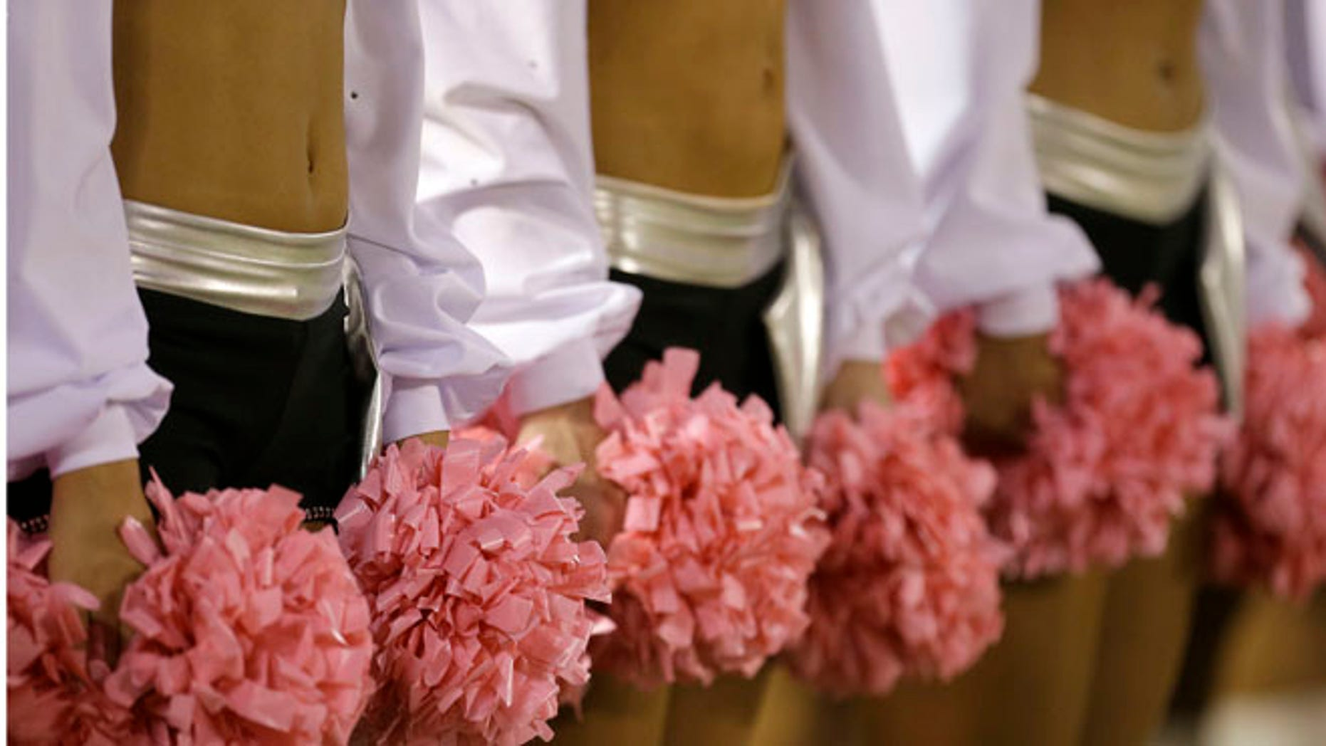 Oct. 6, 2013:Oakland Raiders cheerleaders hold pink pom-poms for breast cancer awareness before an NFL football game between the Raiders and the San Diego Chargers in Oakland, Calif.