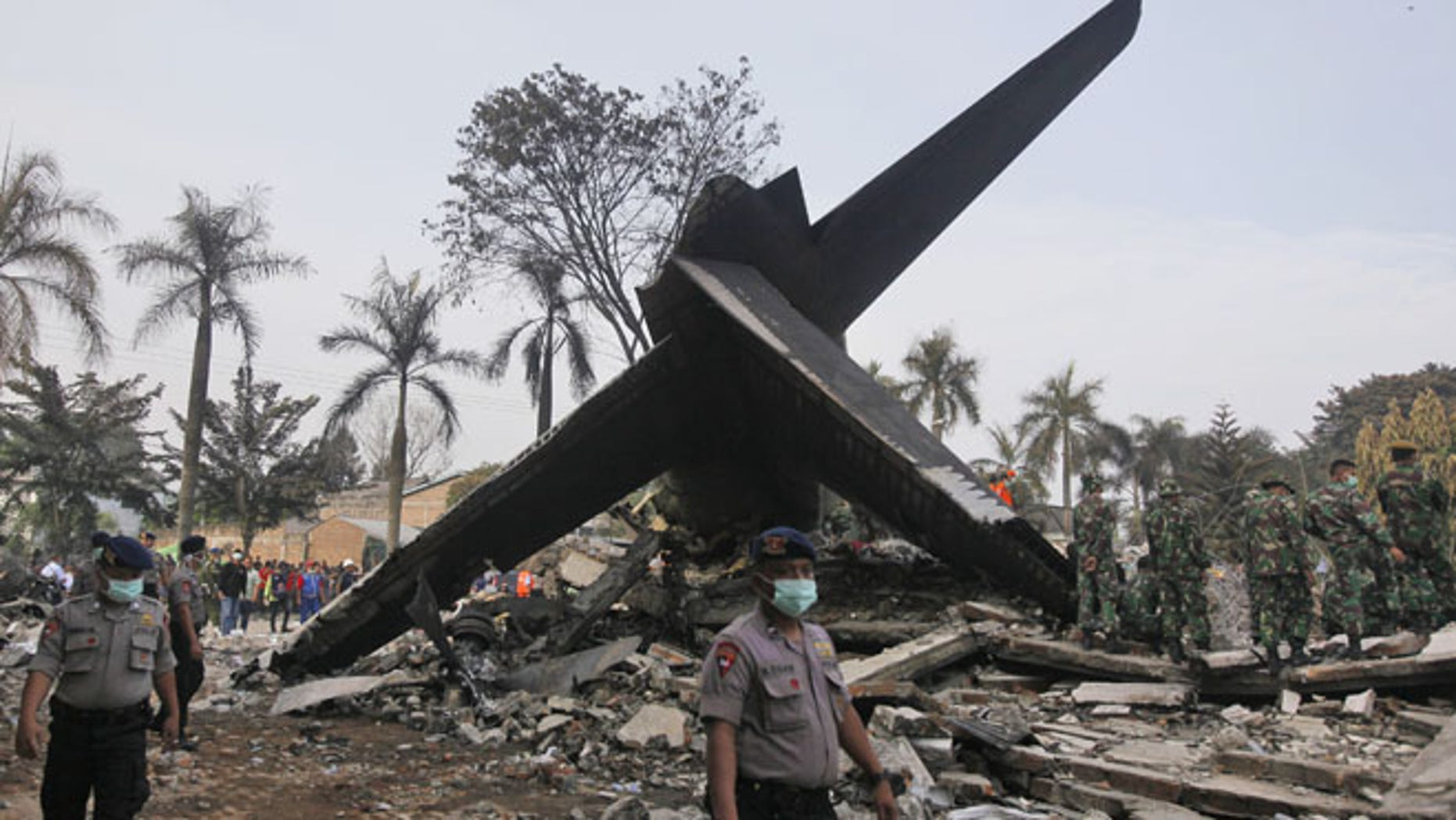 July 1, 2015: Rescuers search for victims at the site where an Indonesian air force transport plane crashed in Medan, North Sumatra, Indonesia.