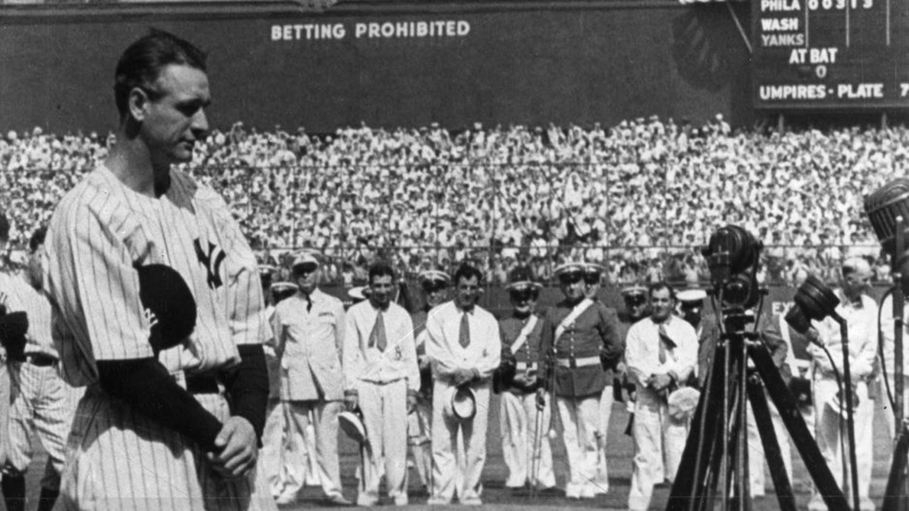 NEW YORK - JULY 4, 1939. Lou Gehrig, first baseman for the New York Yankees, is shown at the microphone during Lou Gehrig Appreciation Day, a farewell to the slugger, at Yankee Stadium on July 4, 1939. (Photo by Mark Rucker/Transcendental Graphics, Getty Images) *** Local Caption *** Lou Gehrig