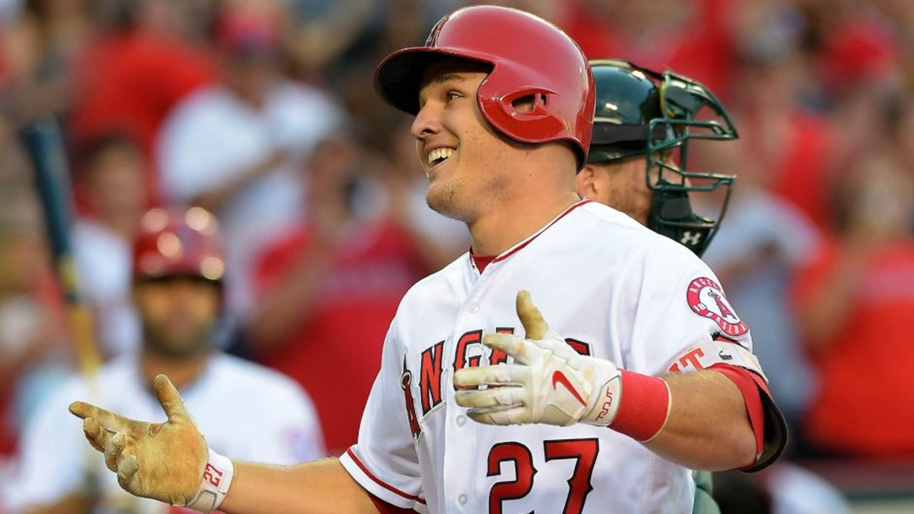 Jun 25, 2016; Anaheim, CA, USA; Los Angeles Angels center fielder Mike Trout (27) crosses the plate after a solo home run off Oakland Athletics relief pitcher Dillon Overton (47) in the first inning of the game at Angel Stadium of Anaheim. Mandatory Credit: Jayne Kamin-Oncea-USA TODAY Sports