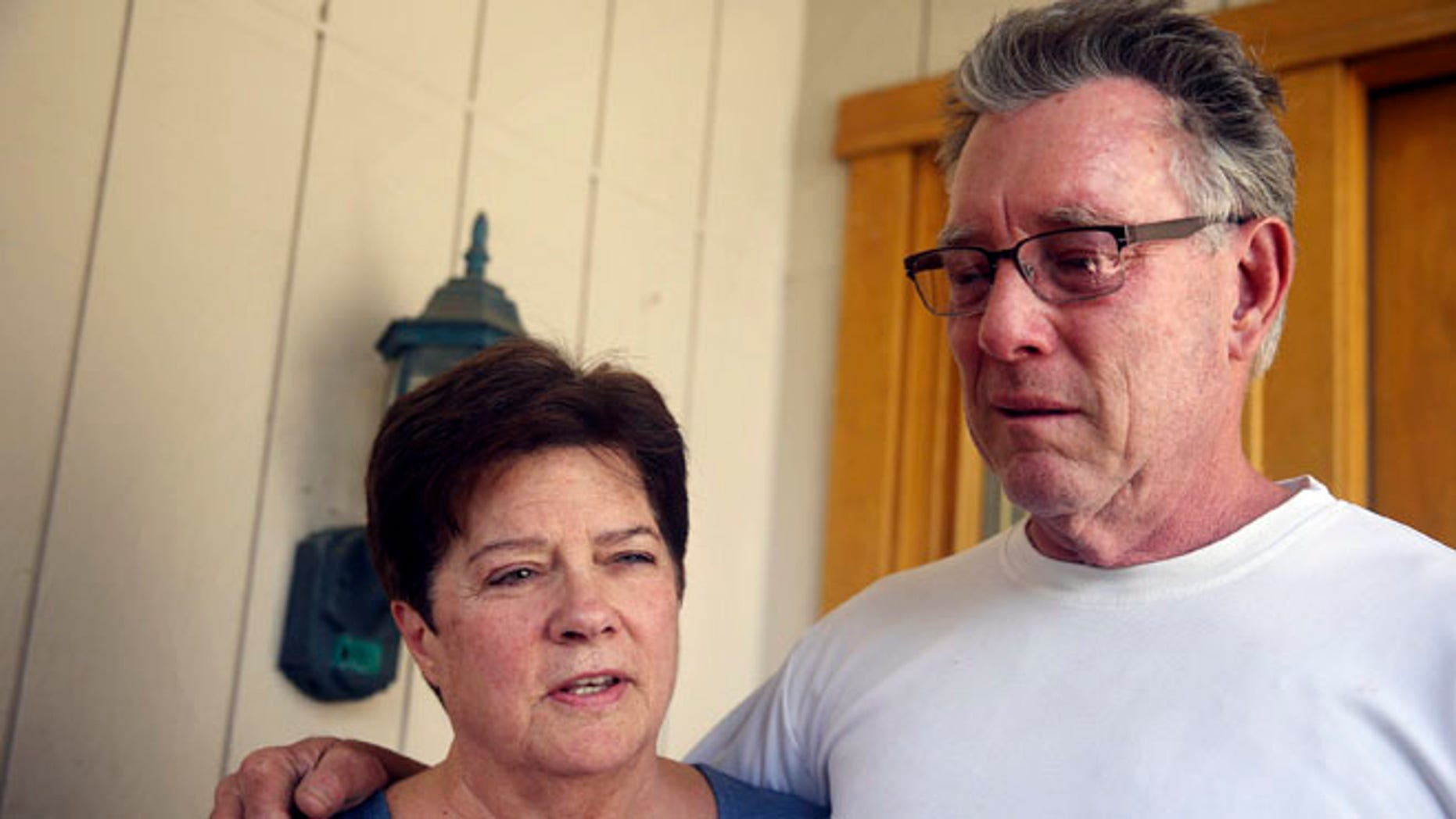 "FILE -- July 2, 2015: Liz Sullivan, left, and Jim Steinle, right, parents of Kathryn ""Kate"" Steinle, talk to members of the media outside their home in Pleasanton, Calif."
