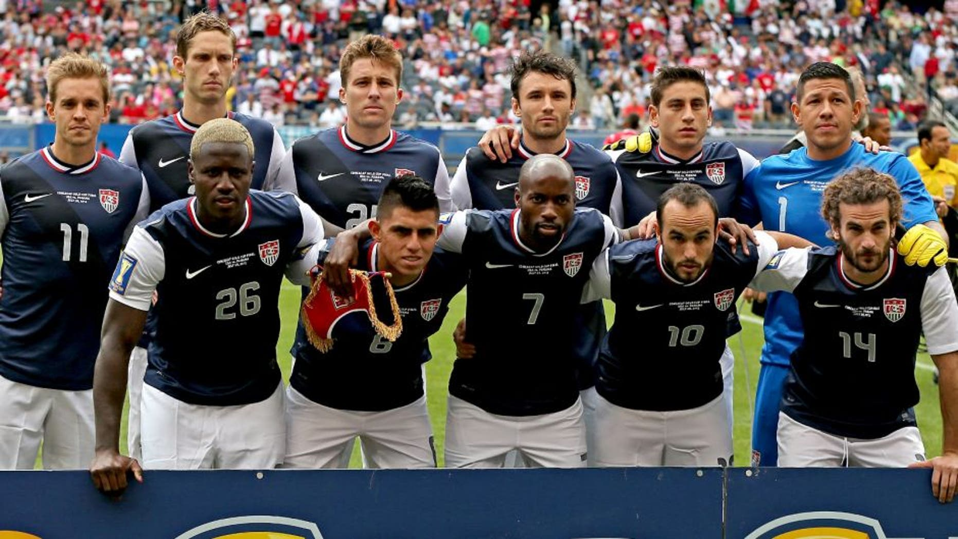 CHICAGO, IL - JULY 28: (Front L-R) Eddie Johnson #26, Joe Cornoa #6, DeMarcus Beasley #7, Landon Donovan #10 and Kyle Beckerman #14 (Back L-R) Stuart Holden #11, Clarence Goodson #21, Matt Besler #25, Michael Parkhurst #15, Alejandro Bedoya and Nick Rimando #1 of the United States pose before the CONCACAF Gold Cup final match against Panama at Soldier Field on July 28, 2013 in Chicago, Illinois. The United States defated Panama 1-0. (Photo by Jonathan Daniel/Getty Images)