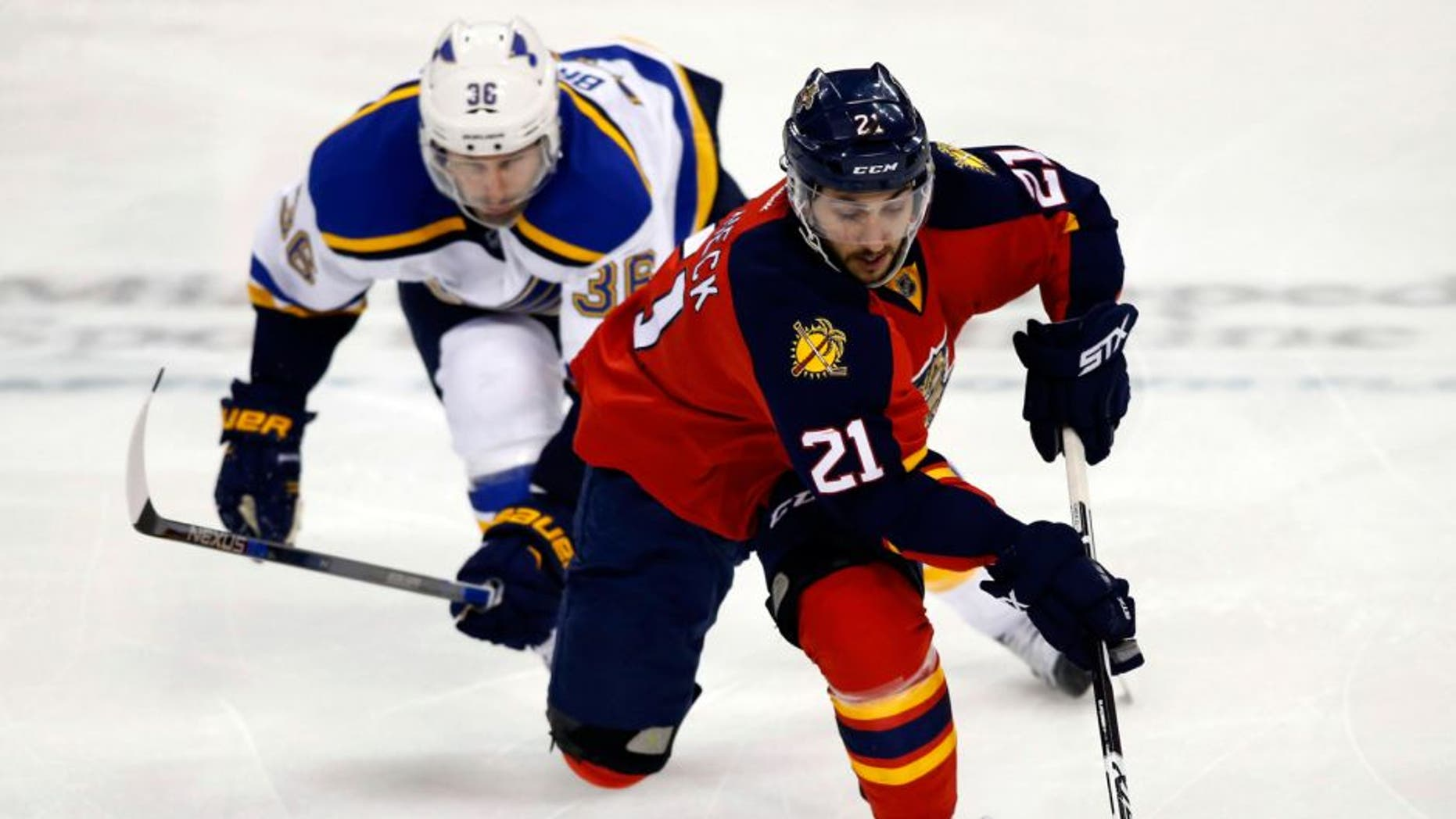 Feb 12, 2016; Sunrise, FL, USA; Florida Panthers center Vincent Trocheck (21) skates with the puck as St. Louis Blues right wing Troy Brouwer (36) pursues in the third period at BB&T Center. The Blues won 5-3. Mandatory Credit: Robert Mayer-USA TODAY Sports