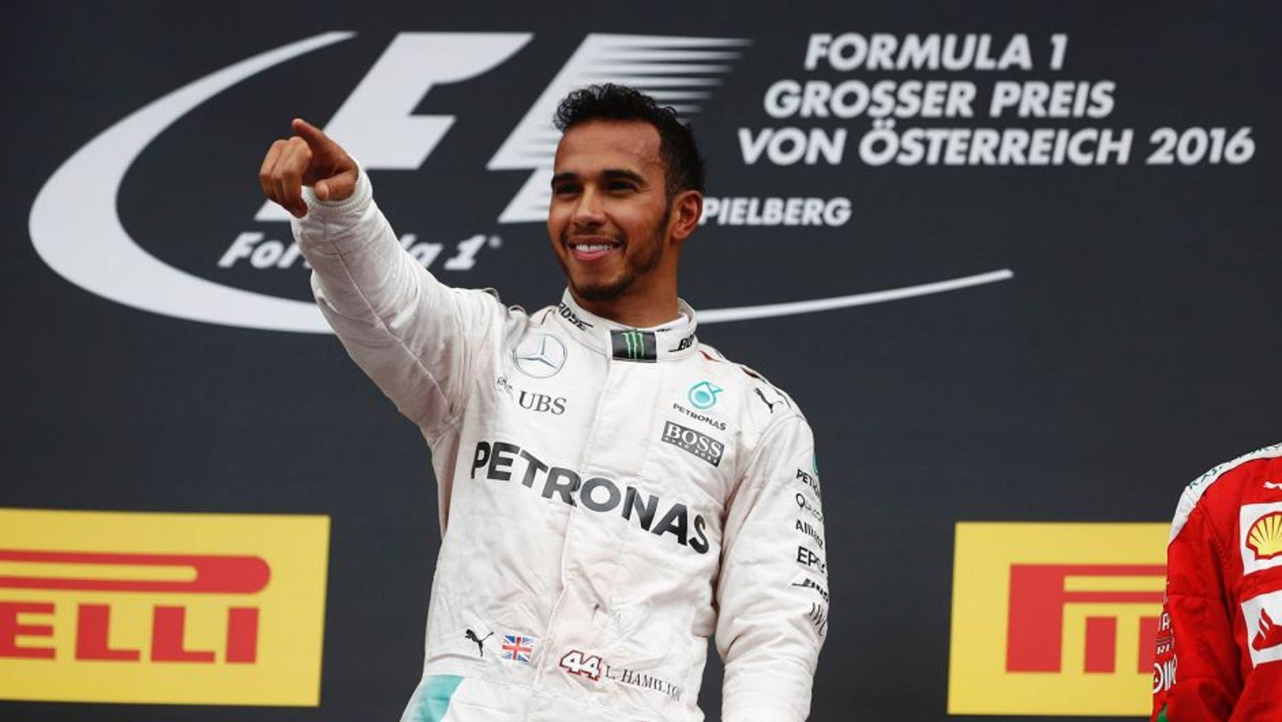 Red Bull Ring, Spielberg, Austria. Sunday 03 July 2016. Lewis Hamilton, Mercedes F1 W07 Hybrid celebrates from the podium after winning the race. World Copyright: Glenn Dunbar/LAT Photographic ref: Digital Image _V2I4263