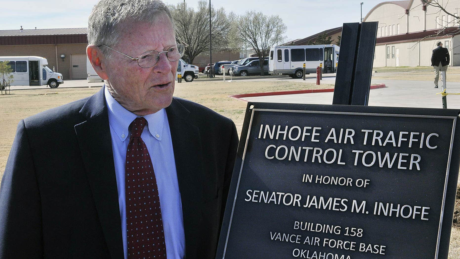 FILE - In this March 4, 2016 file photo, U.S. Senator James Inhofe stands next to a plaque bearing his name after a dedication ceremony for the new air traffic control tower at Vance Air Force Base in Enid, Oklahoma.
