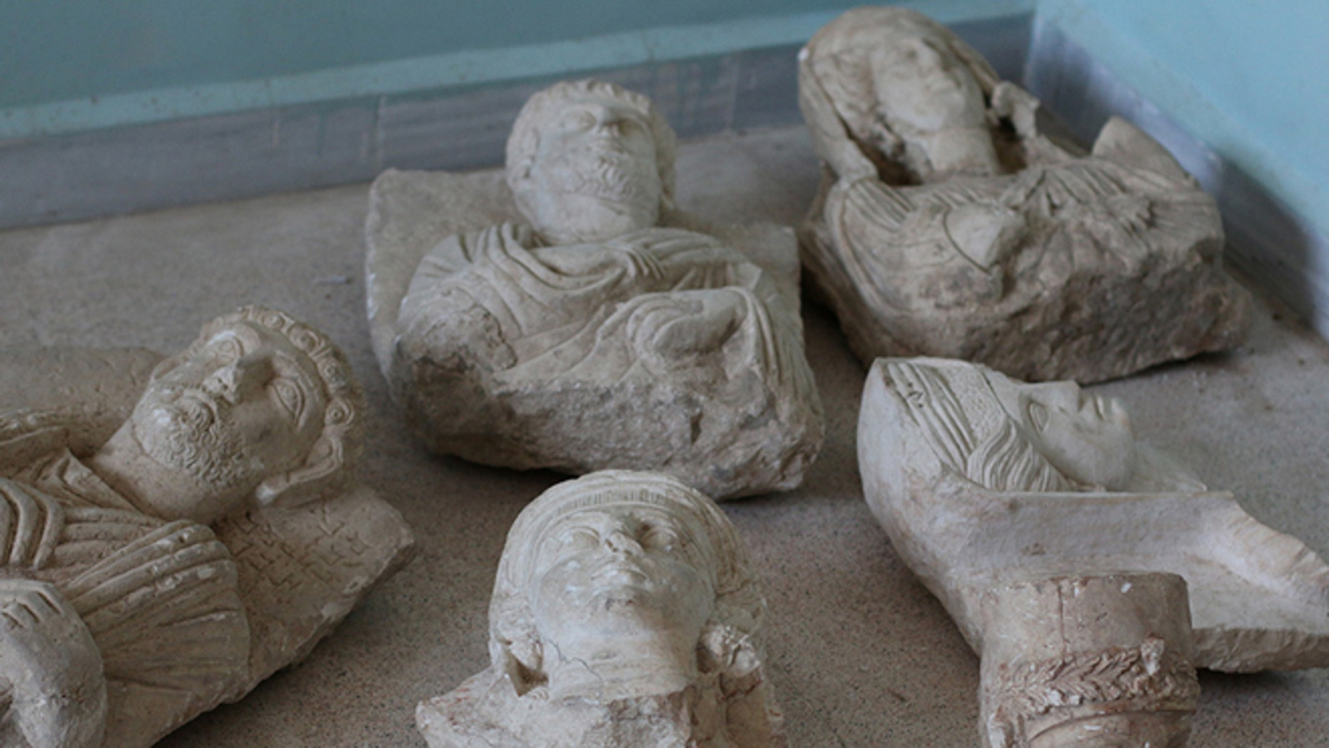 July 3, 2015: This image posted on a militant website by the Aleppo branch of the Islamic State group on which has been verified and is consistent with other AP reporting, shows items that the group claims are six smuggled archaeological pieces from the historic central town of Palmyra.