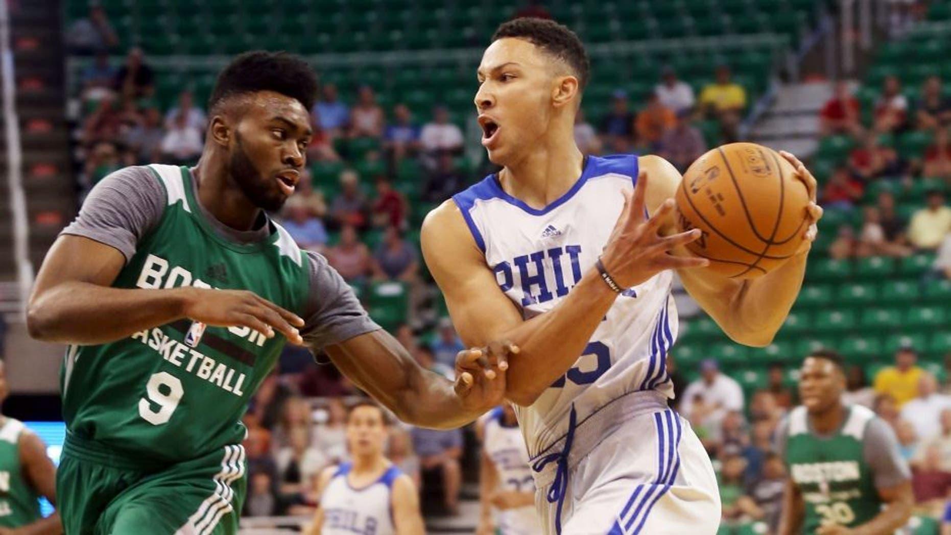 Philadelphia 76ers' Ben Simmons, right, drives the basket past Boston Celtics' Jaylen Brown (9) during an NBA Summer League basketball game Monday, July 4, 2016, in Salt Lake City. (AP Photo/Kim Raff)