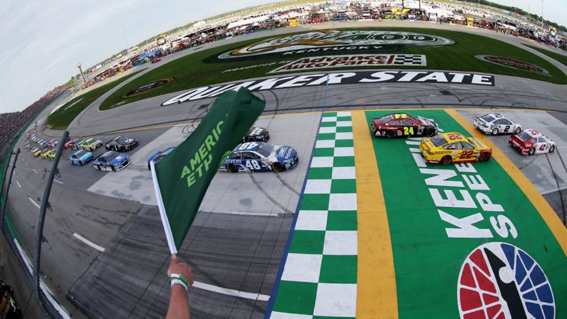 SPARTA, KY - JULY 11: Kyle Larson, driver of the #42 Target Chevrolet, and Brad Keselowski, driver of the #2 Miller Lite Ford, lead the field to the green flag for the running of the NASCAR Sprint Cup Series Quaker State 400 presented by Advance Auto Parts at Kentucky Speedway on July 11, 2015 in Sparta, Kentucky. (Photo by Brian Lawdermilk/NASCAR via Getty Images)