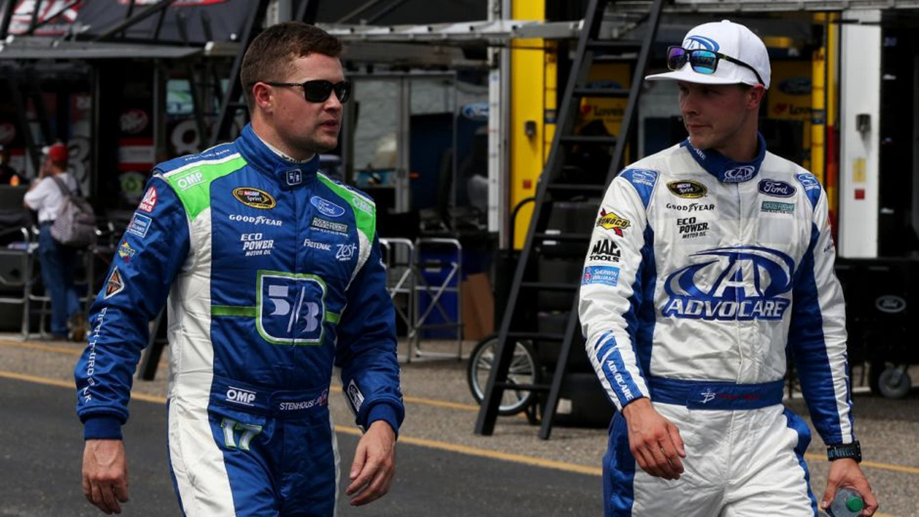 TALLADEGA, AL - APRIL 29: Ricky Stenhouse Jr, driver of the #17 Fifth Third Bank Ford, walks with Trevor Bayne, driver of the #6 AdvoCare Ford, in the garage area during practice for the NASCAR Sprint Cup Series GEICO 500 at Talladega Superspeedway on April 29, 2016 in Talladega, Alabama. (Photo by Matt Sullivan/NASCAR via Getty Images)