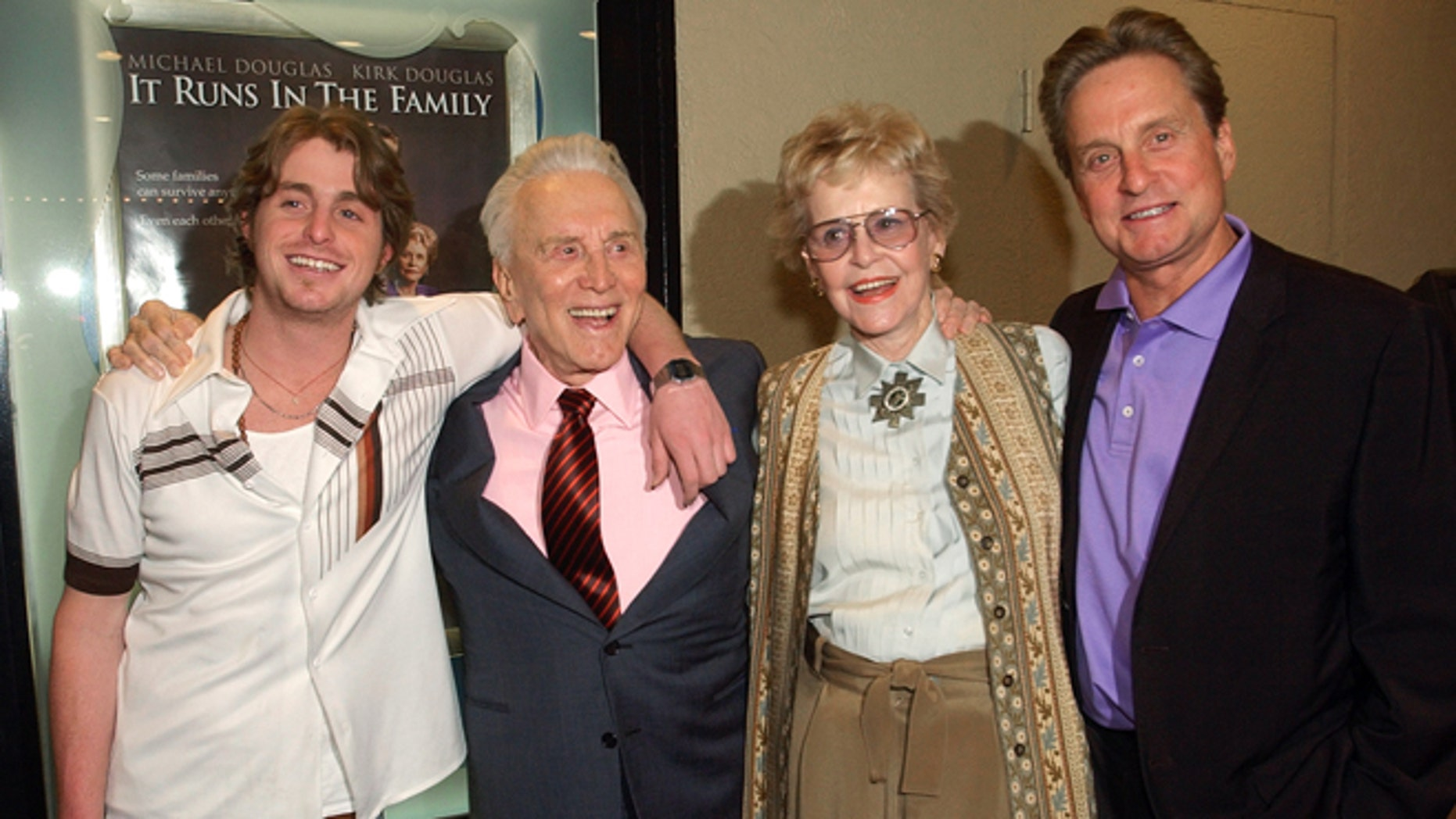 "April 7, 2003: Actor Kirk Douglas, second from left, poses with his ex-wife Diana Douglas, second from right, their son Michael Douglas, right, and Michael's son Cameron Douglas, left, at a special screening of the film ""It Runs in the Family"" in Los Angeles."