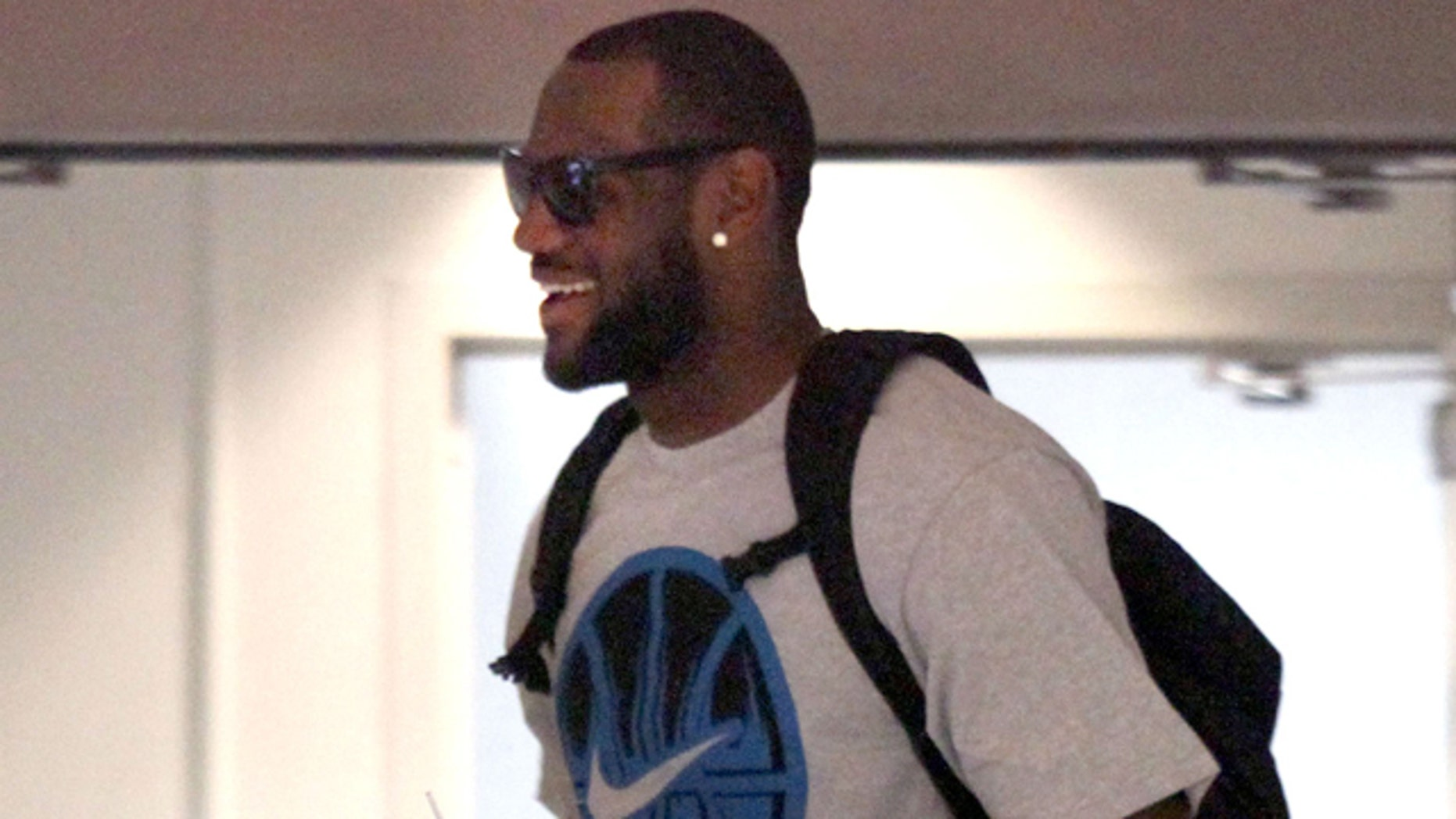 July 2: Free agent basketball player LeBron James makes his way through the IMG building to talk with the Miami Heat in Cleveland.