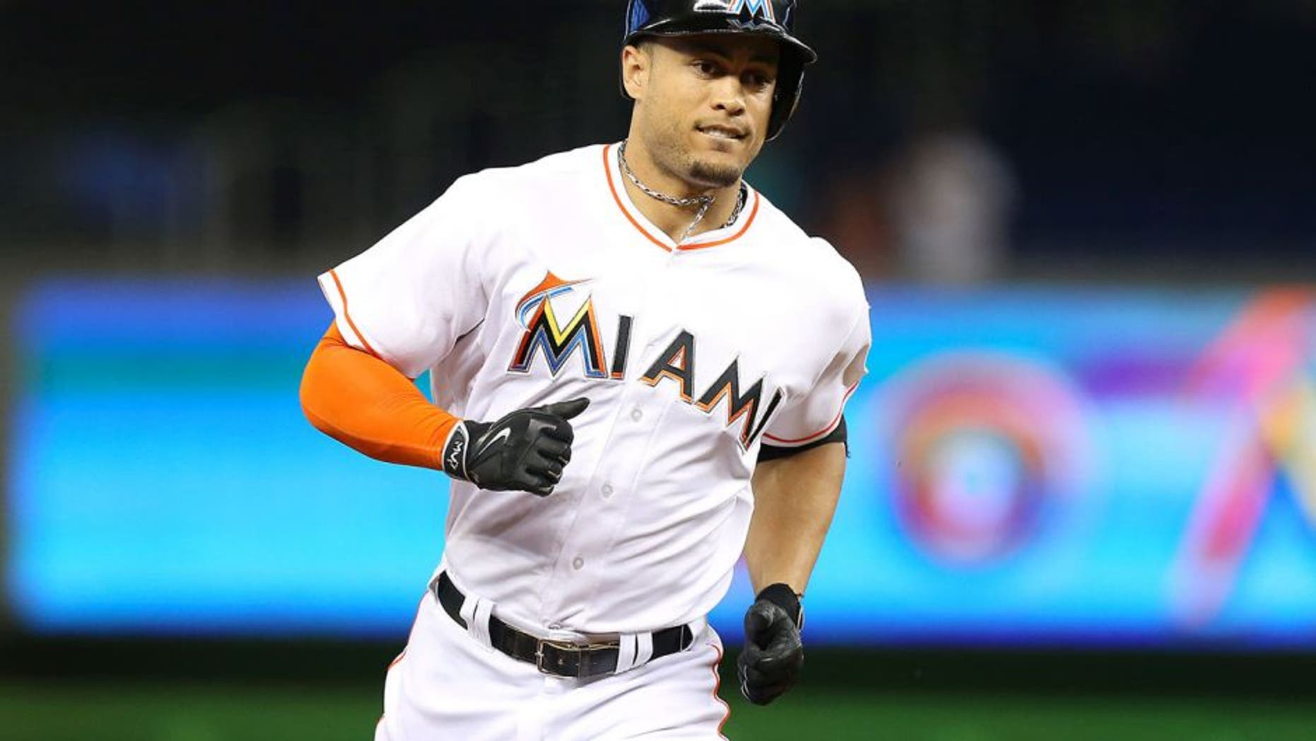 The Miami Marlins' Giancarlo Stanton rounds third after hitting a solo home run in the second inning against the St. Louis Cardinals on Wednesday, June 24, 2015, at Marlins Park in Miami. The Cards won, 6-1. (David Santiago/El Nuevo Herald/TNS via Getty Images)
