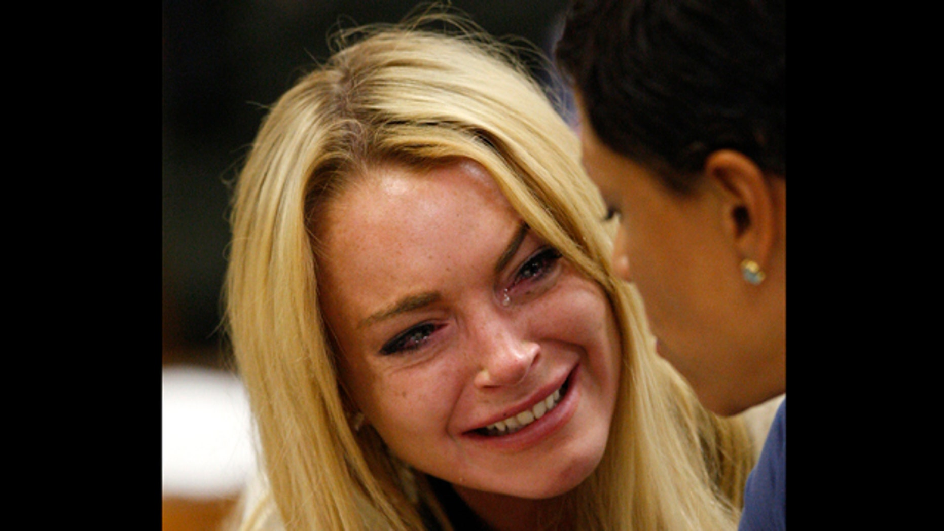 July 6: Actress Lindsay Lohan reacts after the sentencing by Superior Court Judge Marsha Reve during a hearing in Beverly Hills, Calif.