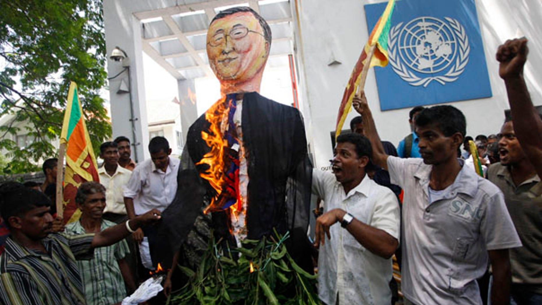 July 6: Sri Lankan protesters wave their national flags and burn an effigy of U.N. Secretary General Ban Ki-moon outside the U.N. office in Colombo, Sri Lanka.