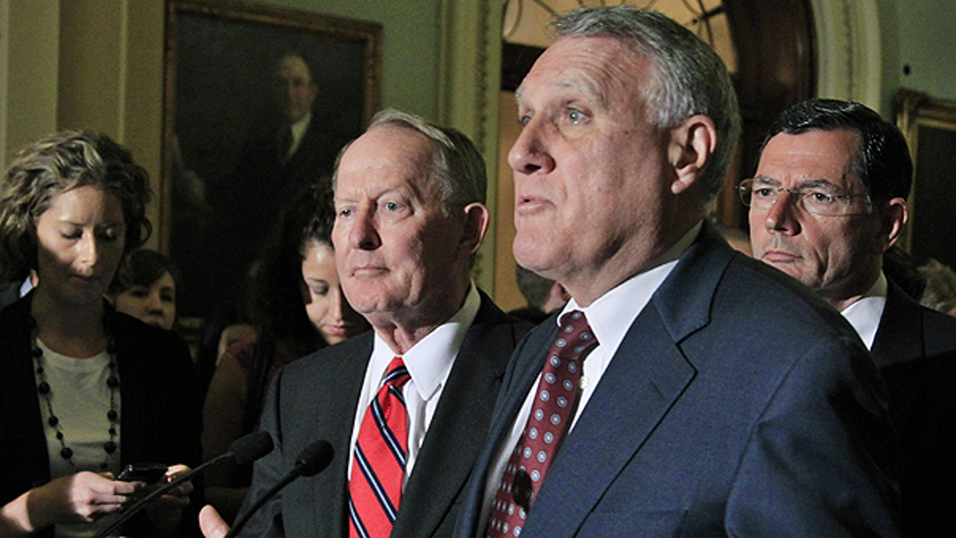July 6: Senate Minority Whip Jon Kyl of Ariz., center, accompanied by Sen. Lamar Alexander, R-Tenn., left, and Sen. John Barrasso, R-Wyo., speaks on Capitol Hill in Washington.