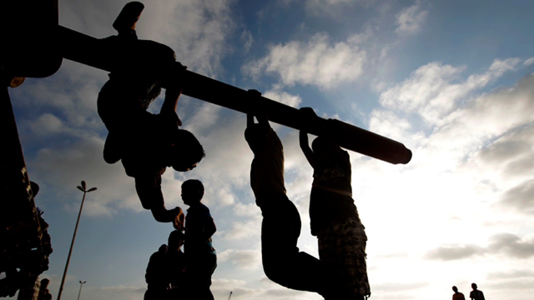 July 2: Libyan boys sit on the cannon of a destroyed army tank in the rebel-held Benghazi, Libya.