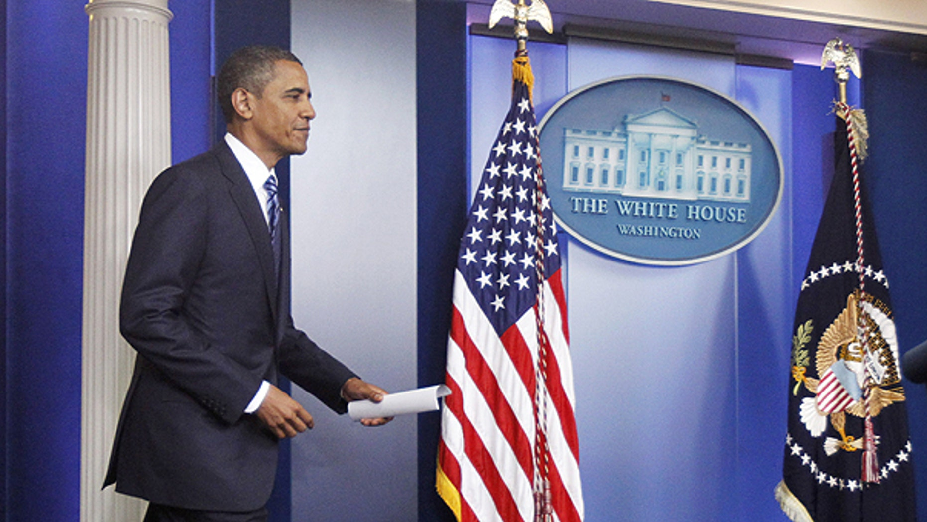 July 5: Obama arrives in the James Brady Press Briefing Room of the White House in Washington to make a statement to reporters about debt ceiling negotiations.