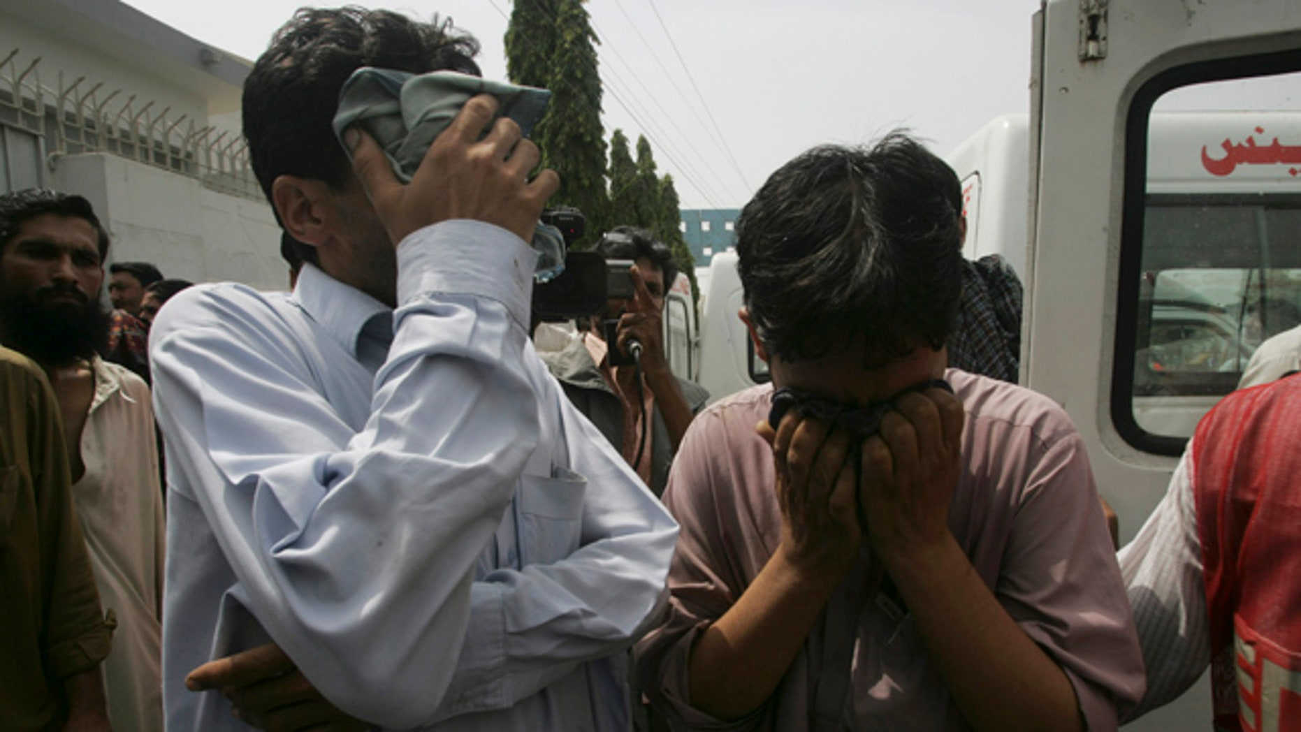 July 6: People mourn the death of their family member who was shot dead in Karachi, Pakistan.