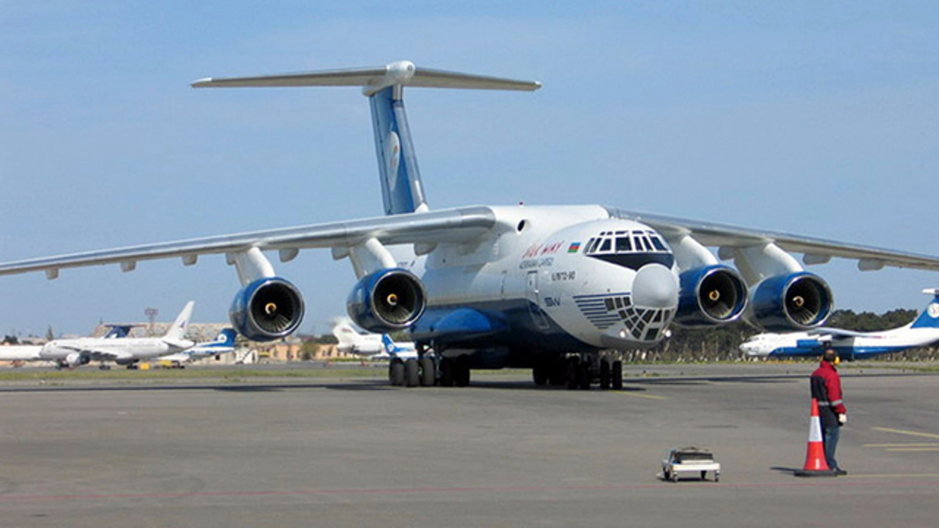 This undated photo provided by Silkway Airlines press service shows an  IL-76TD-90SW cargo plane seen in an undisclosed location.