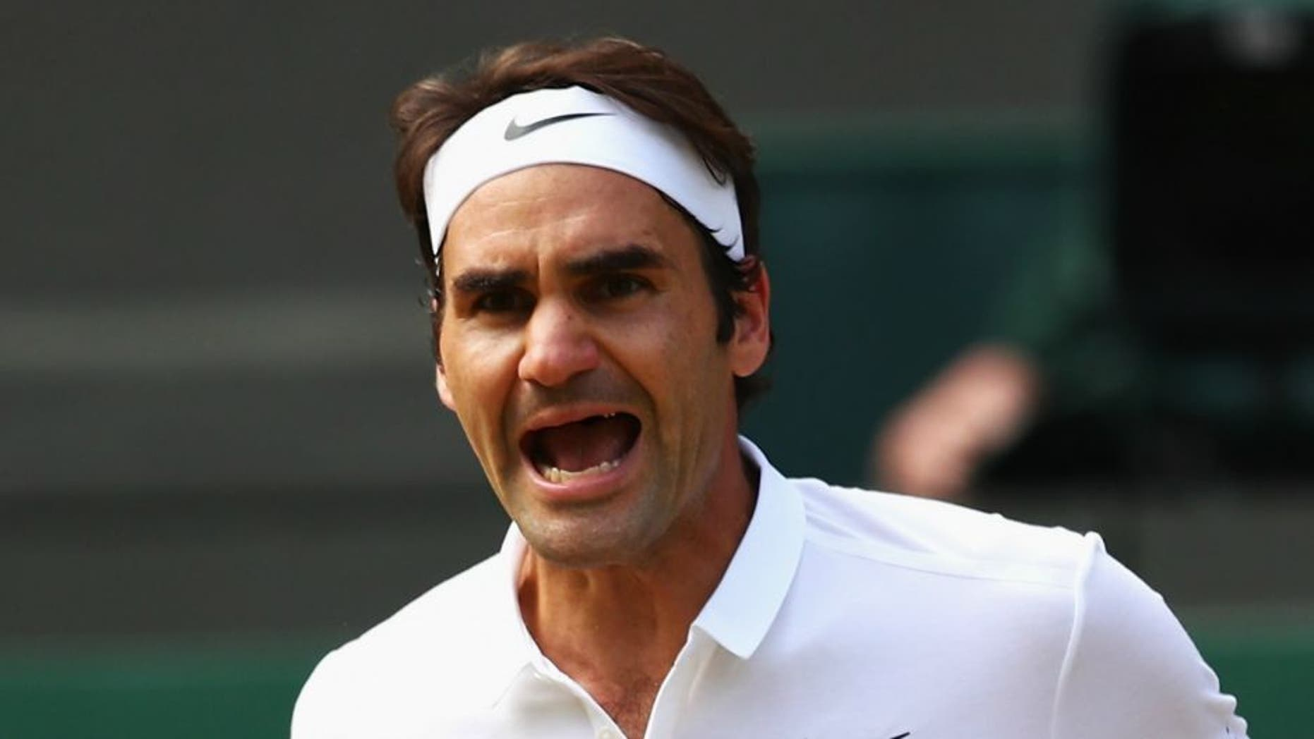 LONDON, ENGLAND - JULY 06: Roger Federer of Switzerland celebrates during the Men's Singles Quarter Finals match against Marin Cilic of Croatia on day nine of the Wimbledon Lawn Tennis Championships at the All England Lawn Tennis and Croquet Club on July 6, 2016 in London, England. (Photo by Clive Brunskill/Getty Images)
