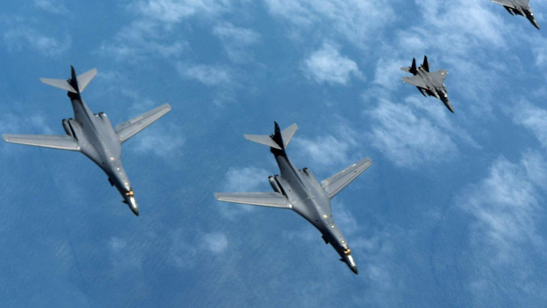 Two U.S. Air Force B-1B Lancers assigned to the 9th Expeditionary Bomb Squadron fly a 10-hour mission from Andersen Air Force Base, Guam, with two South Korean air force F-15s in the vicinity of the Korean peninsula.