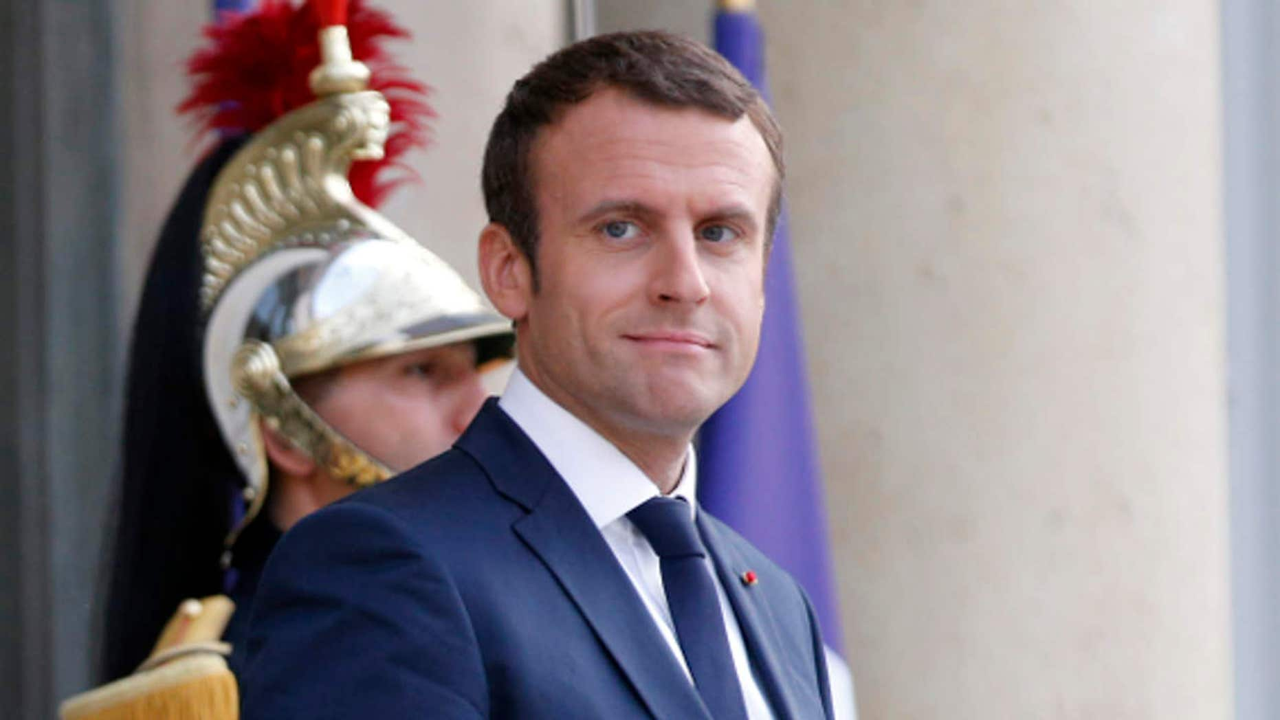 France's President Emmanuel Macron waits prior to welcoming Mexico's President Enrique Pena Nieto, for a dinner at the Elysee Palace, in Paris, Thursday, July 6, 2017.