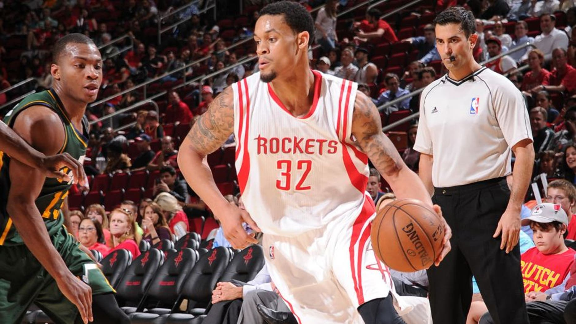 HOUSTON, TX - APRIL 15: K.J. McDaniels #32 of the Houston Rockets handles the ball against the Utah Jazz on April 15, 2015 at the Toyota Center in Houston, Texas. NOTE TO USER: User expressly acknowledges and agrees that, by downloading and or using this photograph, User is consenting to the terms and conditions of the Getty Images License Agreement. Mandatory Copyright Notice: Copyright 2015 NBAE (Photo by Bill Baptist/NBAE via Getty Images)