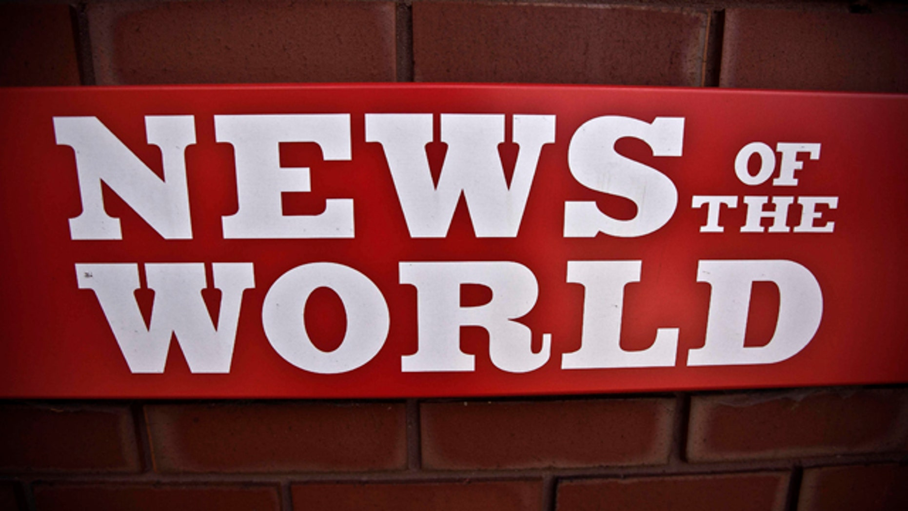 July 6: News of the World sign is seen by an entrance at premises of News International in London.