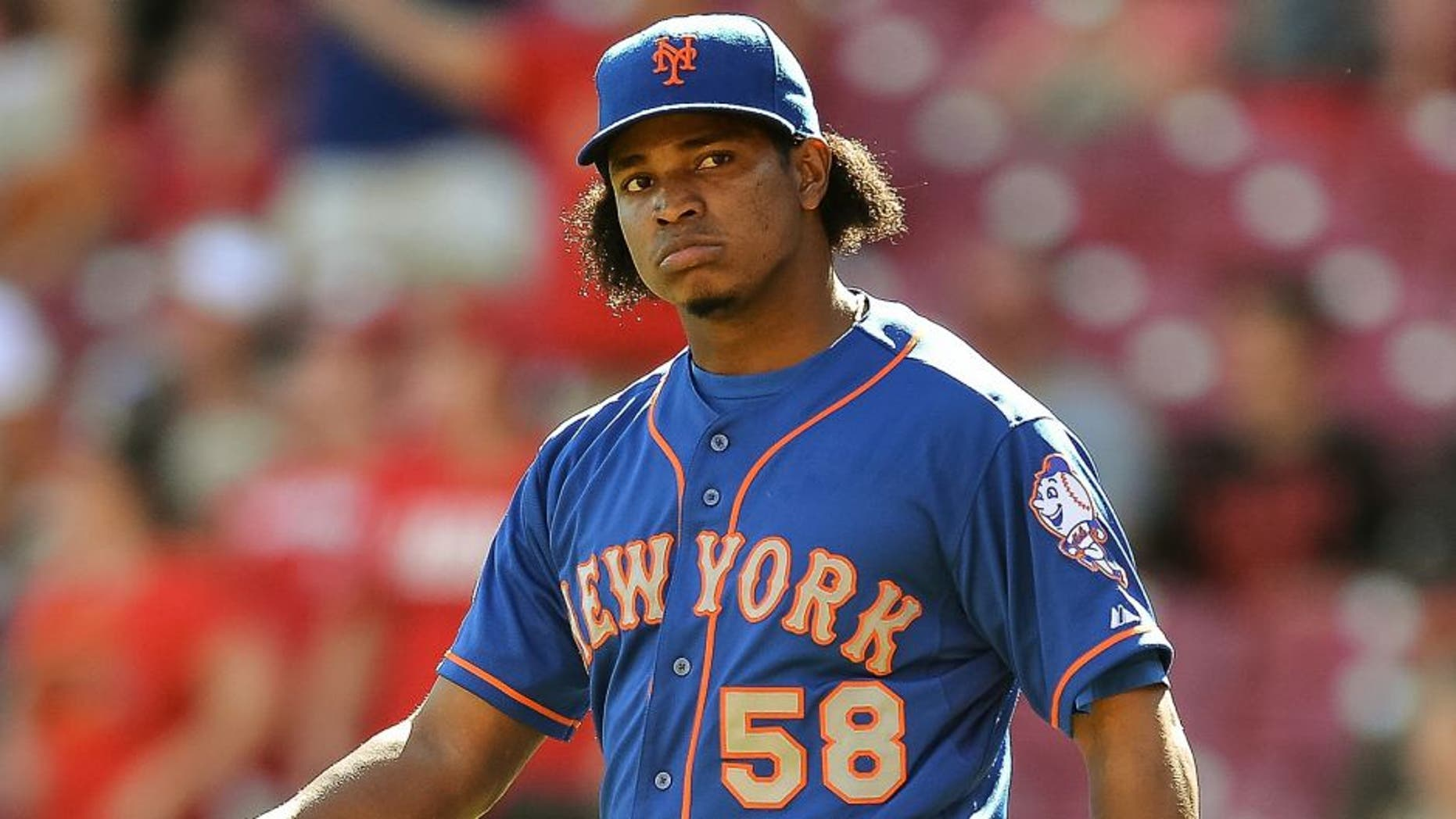 CINCINNATI, OH - SEPTEMBER 7: Jenrry Mejia #58 of the New York Mets pitches against the Cincinnati Reds at Great American Ball Park on September 7, 2014 in Cincinnati, Ohio. (Photo by Jamie Sabau/Getty Images) *** Local Caption *** Jenrry Mejia