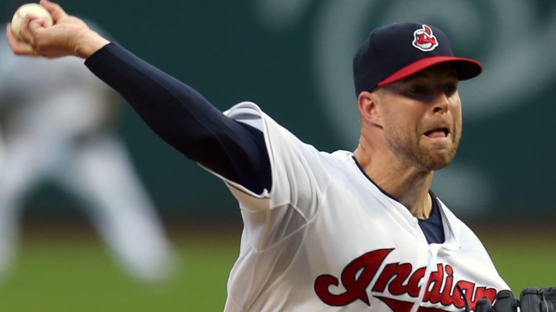 Cleveland Indians starting pitcher Corey Kluber pitches to Houston Astros' Preston Tucker during the first inning of a baseball game, Tuesday, July 7, 2015, in Cleveland.