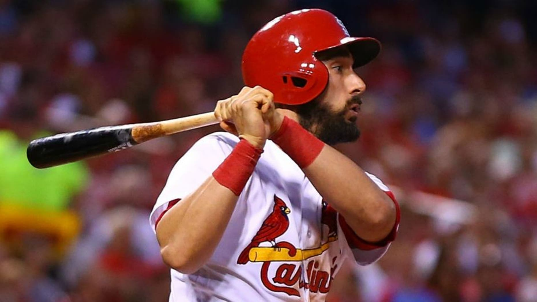 ST. LOUIS, MO - JULY 1: Matt Carpenter #13 of the St. Louis Cardinals hits an RBI single against the Milwaukee Brewers in the fourth inning at Busch Stadium on July 1, 2016 in St. Louis, Missouri. (Photo by Dilip Vishwanat/Getty Images)