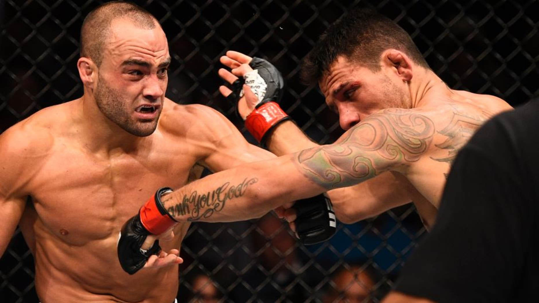 LAS VEGAS, NV - JULY 07: (L-R) Eddie Alvarez connects with a left against Rafael Dos Anjos of Brazil in their lightweight championship bout during the UFC Fight Night event inside the MGM Grand Garden Arena on July 7, 2016 in Las Vegas, Nevada. (Photo by Jeff Bottari/Zuffa LLC/Zuffa LLC via Getty Images)