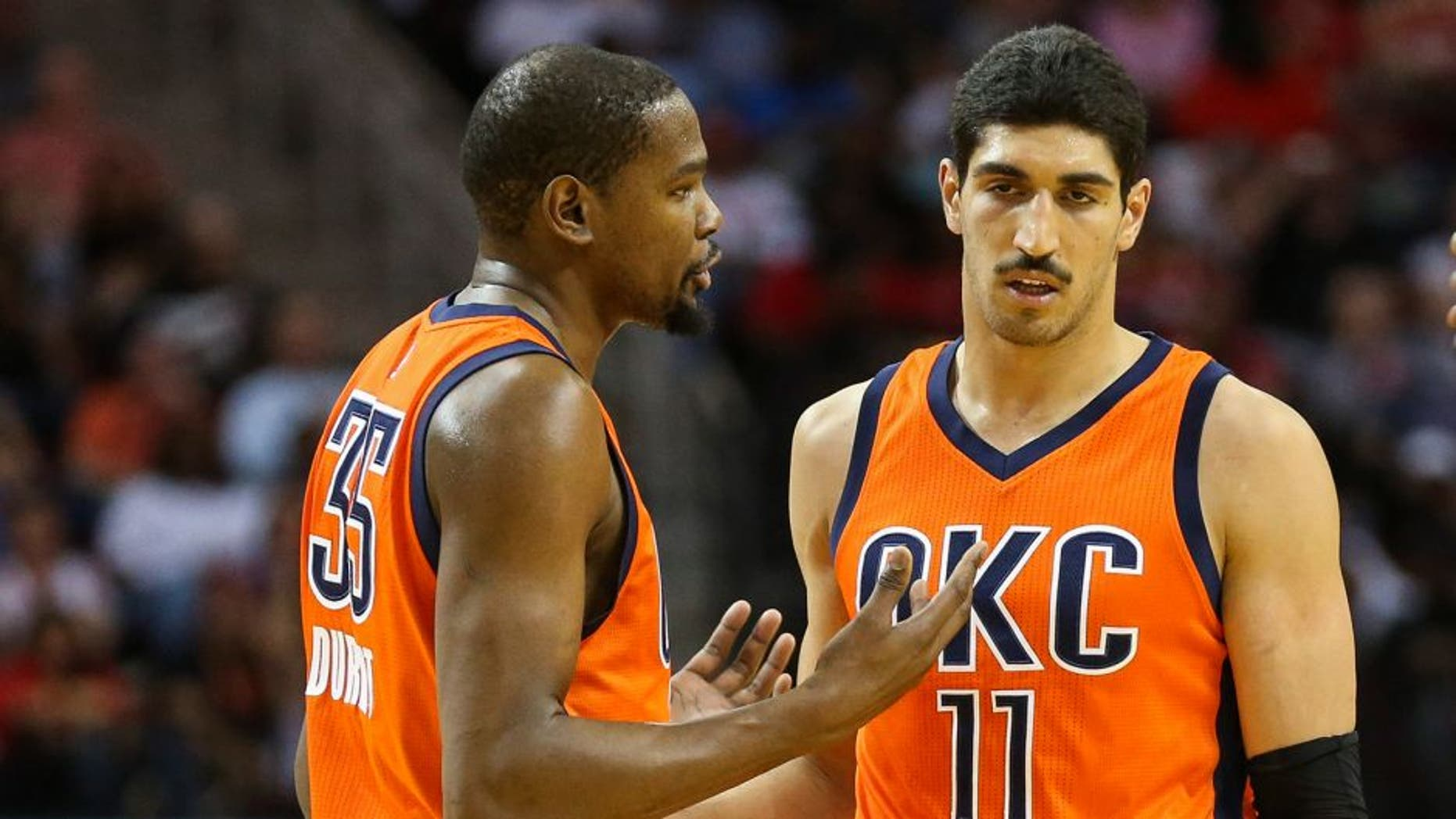 Apr 3, 2016; Houston, TX, USA; Oklahoma City Thunder forward Kevin Durant (35) talks with center Enes Kanter (11) and guard Randy Foye (6) during the second half against the Houston Rockets at Toyota Center. The Rockets won 118-110. Mandatory Credit: Troy Taormina-USA TODAY Sports