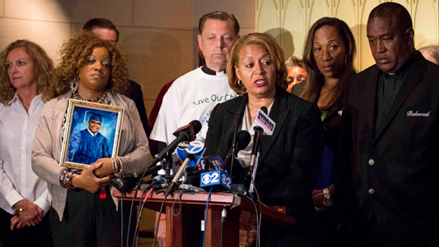 July 7, 2015: Annette Nance-Holt, who lost her 16-year-old son, Blair, to gun-violence in 2007, speaks at a press conference in Chicago, after lawyers for the Coalition for Safe Chicago Communities filed a lawsuit in Cook County suing three suburbs for not adequately monitoring gun stores they believe are the source of weapons that have filtered into the city.