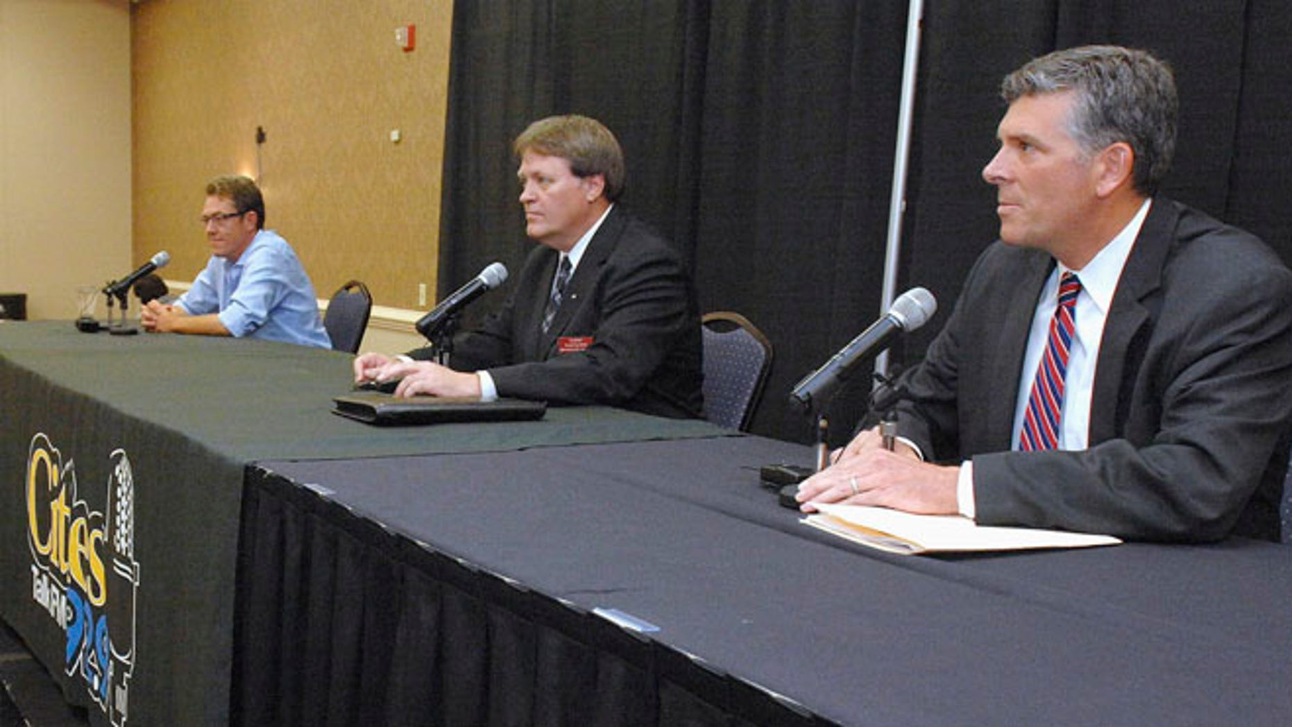 June 24, 2015: Republican candidates in a primary to fill Illinois 18th District seat from left, Michael Flynn, Donald Rients and Illinois state Sen. Darin LaHood prepare for a debate in Bloomington, Ill.
