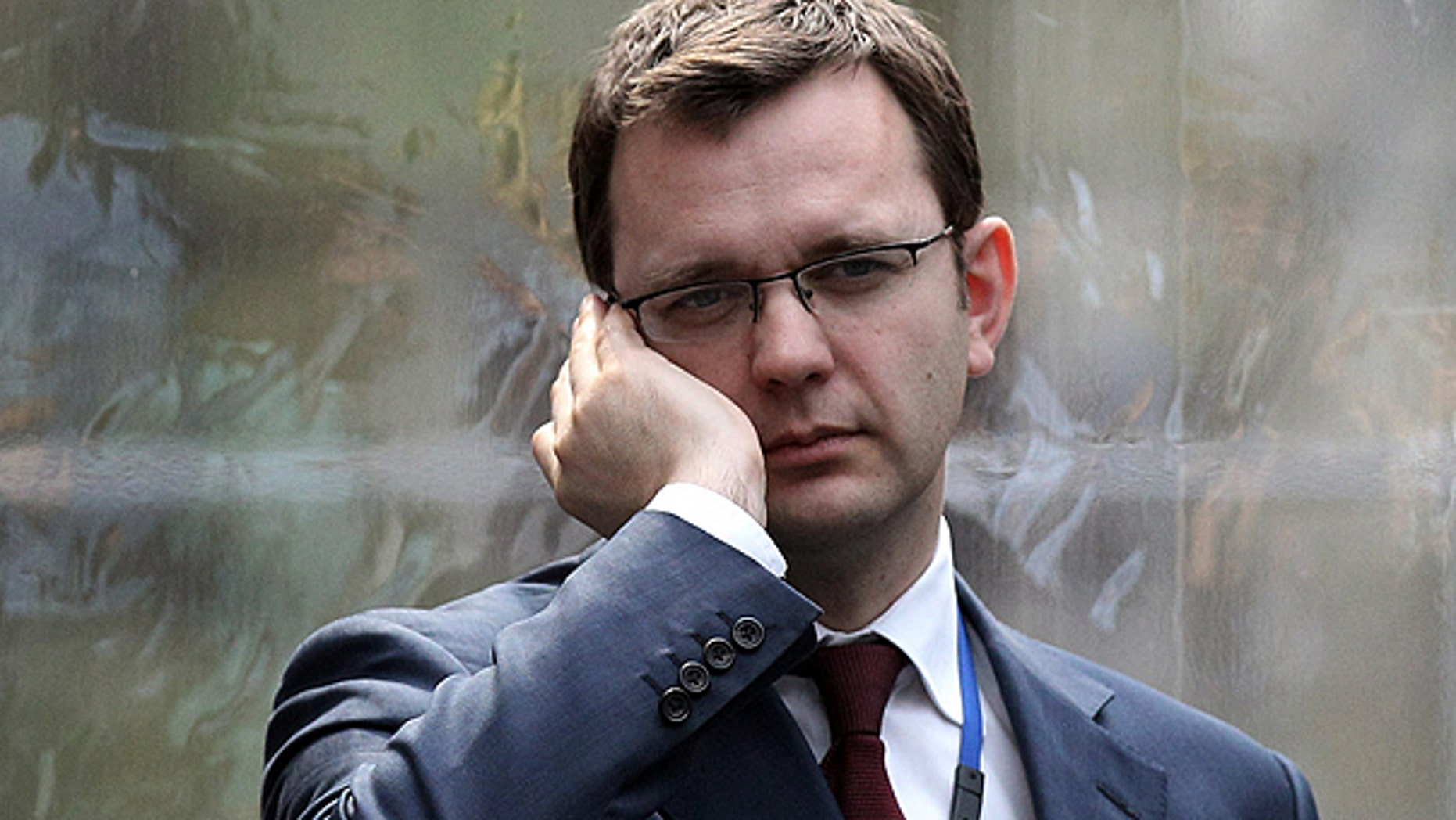 Andy Coulson, formerly editor of the tabloid News of the World, and later David Cameron's director of communications, speaks on a mobile phone in London, in this April 13, 2010, file photo.