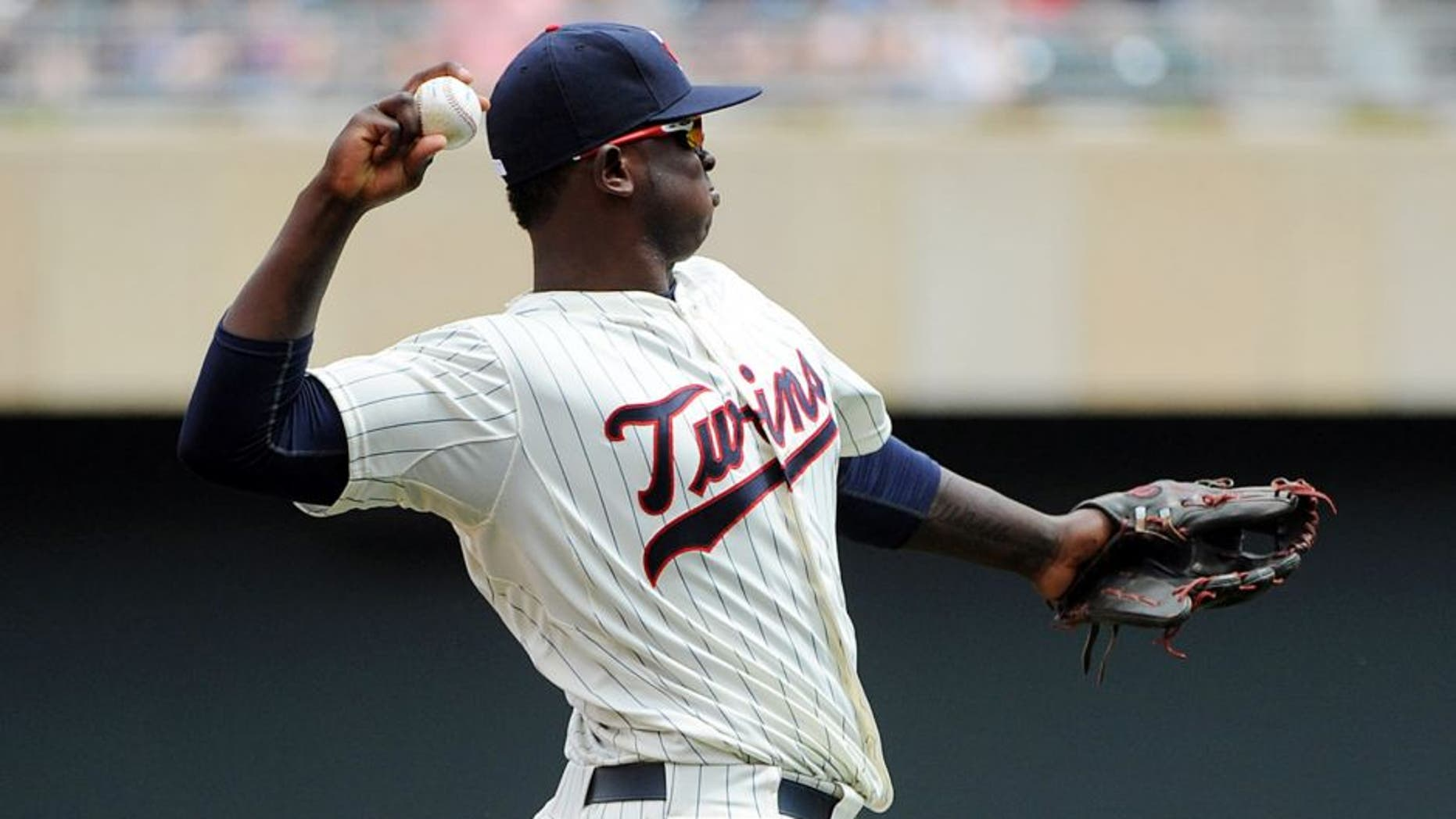 Jul 8, 2015; Minneapolis, MN, USA; Minnesota Twins third baseman Miguel Sano (22) warms up prior to the ninth inning against the Baltimore Orioles at Target Field. The Twins win 5-3 over the Orioles. Mandatory Credit: Marilyn Indahl-USA TODAY Sports