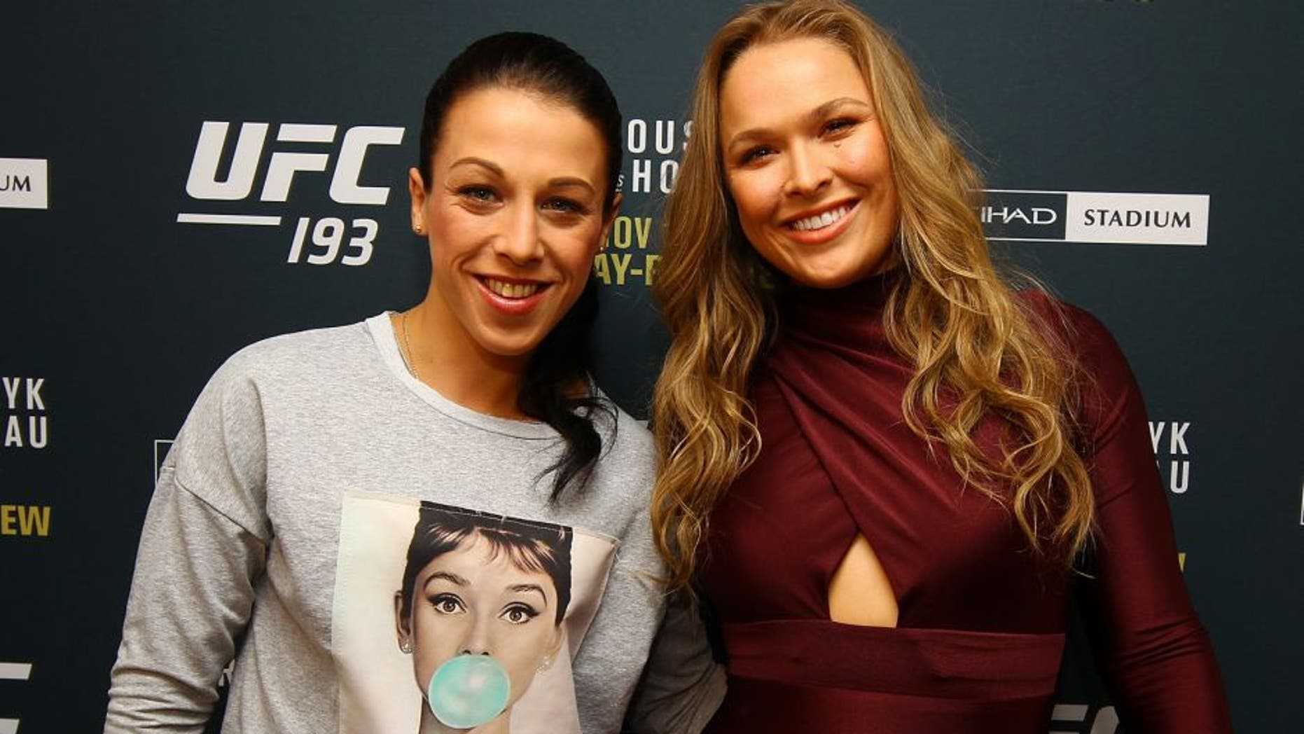 NEW YORK, NY - OCTOBER 06: (R-L) UFC women's bantamweight champion Ronda Rousey and UFC women's strawweight champion Joanna Jedrzejczyk pose for a photo at the London NYC hotel ahead of UFC 193 on October 6, 2015 in New York, United States. (Photo by Mike Stobe/Zuffa LLC/Zuffa LLC via Getty Images)