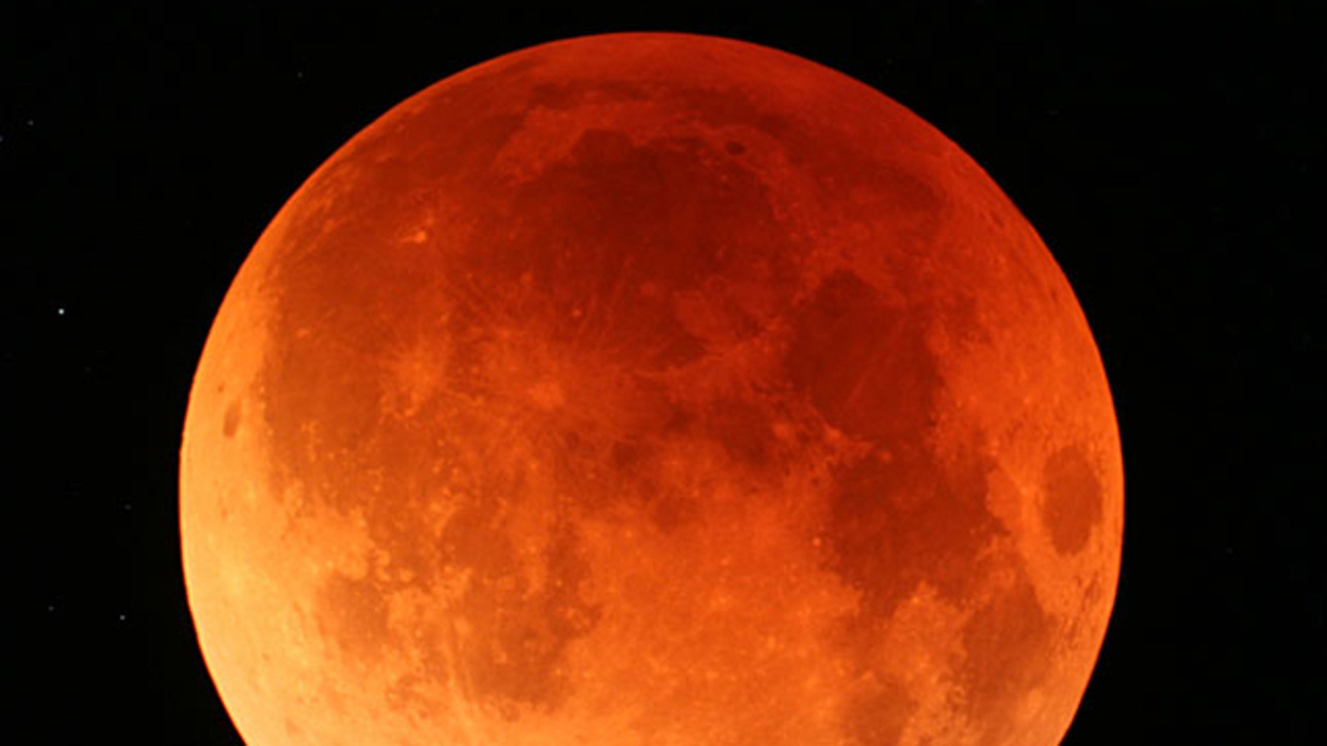 A view of the lunar eclipse from Japan's northernmost main island of Hokkaido on Aug. 28, 2007. The Earth's shadow crept across the moon's surface slowly eclipsing it and turning it to shades of orange and red during second total lunar eclipse this year.