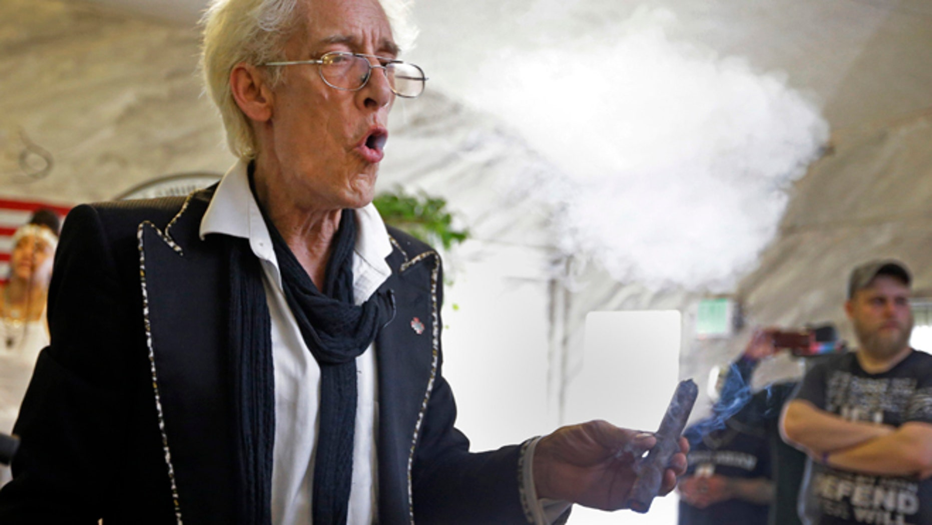 """July 1, 2015: First Church of Cannabis Founder Bill Levin exhales as he smokes a """"sacrament substitute"""" during the church's first service in Indianapolis."""