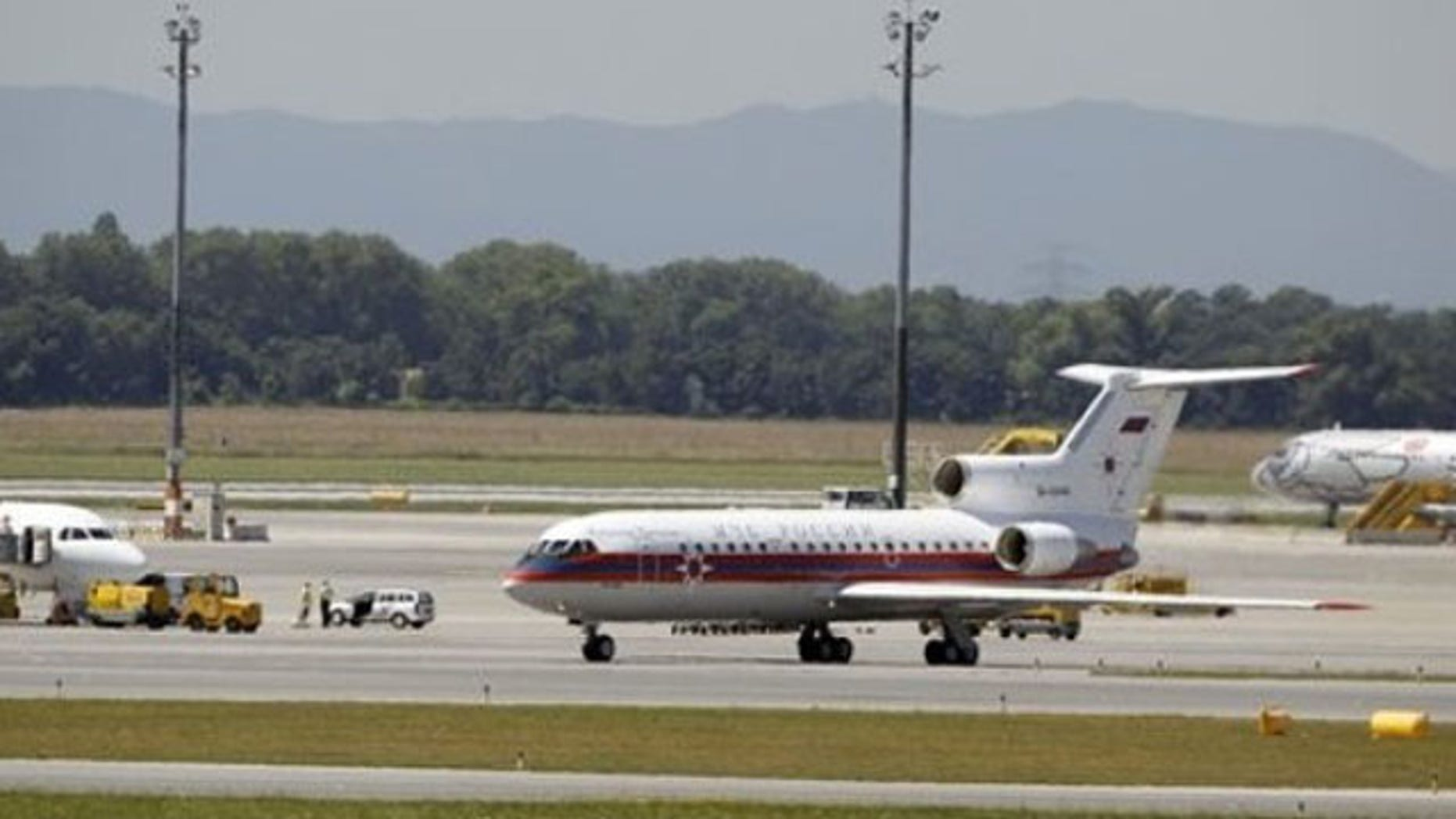 July 9: A Russian plane believed to be carrying candidates for a 14-person spy swap as part of the largest spy swap since the Cold War is parked on the tarmac at Vienna's Schwechat airport (AP).