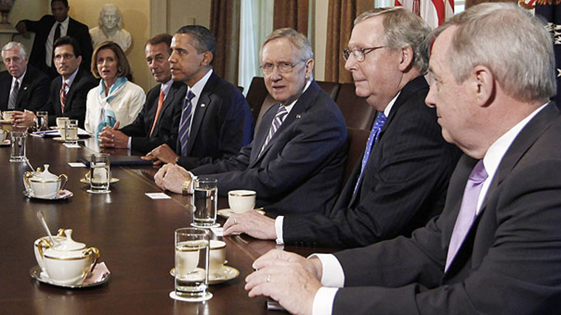 July 7: President Barack Obama meets with the Congressional leadership in the Cabinet Room of the White House in Washington, to discuss the debt. From left are, House Minority Whip Steny Hoyer of Md., House Majority Leader Eric Cantor of Va., House Minority Leader Nancy Pelosi of Calif., House Speaker John Boehner of Ohio, the president, Senate Majority Leader Harry Reid of Nev., Senate Minority Leader Mitch McConnell of Ky., and Senate Majority Whip Richard Durbin of Ill.