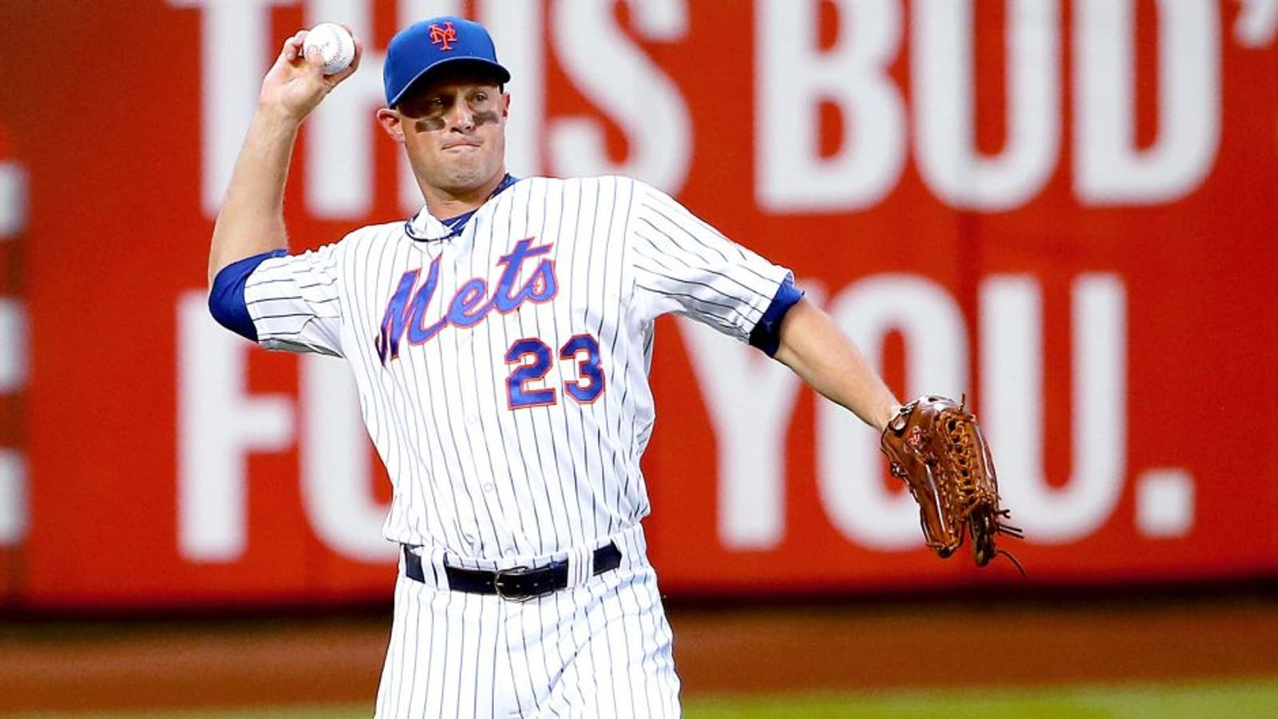 NEW YORK, NY - JUNE 30: Michael Cuddyer #23 of the New York Mets fields the ball in the third inning against the Chicago Cubs on June 30, 2015 at Citi Field in the Flushing Neighborhood of the Queens borough of New York City. (Photo by Nate Shron/Getty Images)