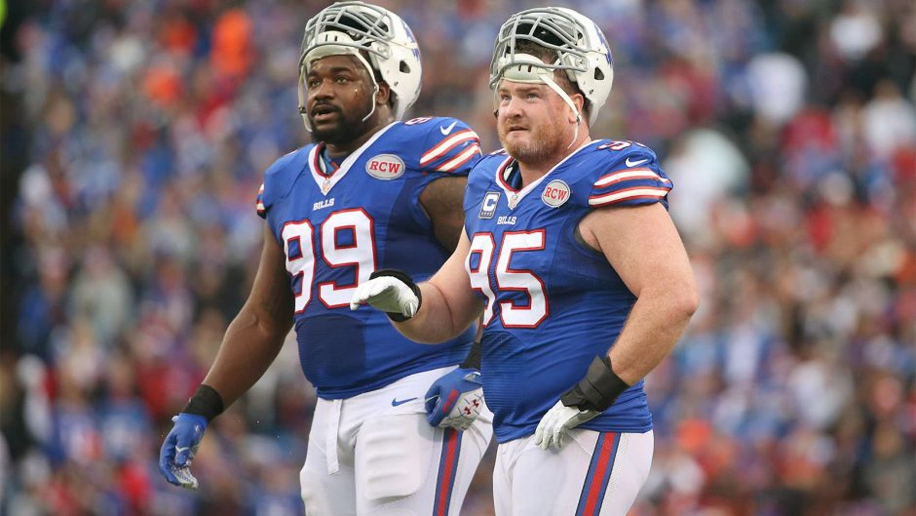 ORCHARD PARK, NY - NOVEMBER 30: Kyle Williams #95 of the Buffalo Bills and Marcell Dareus #99 look on during NFL game action against the Cleveland Browns at Ralph Wilson Stadium on November 30, 2014 in Orchard Park, New York. (Photo by Tom Szczerbowski/Getty Images)