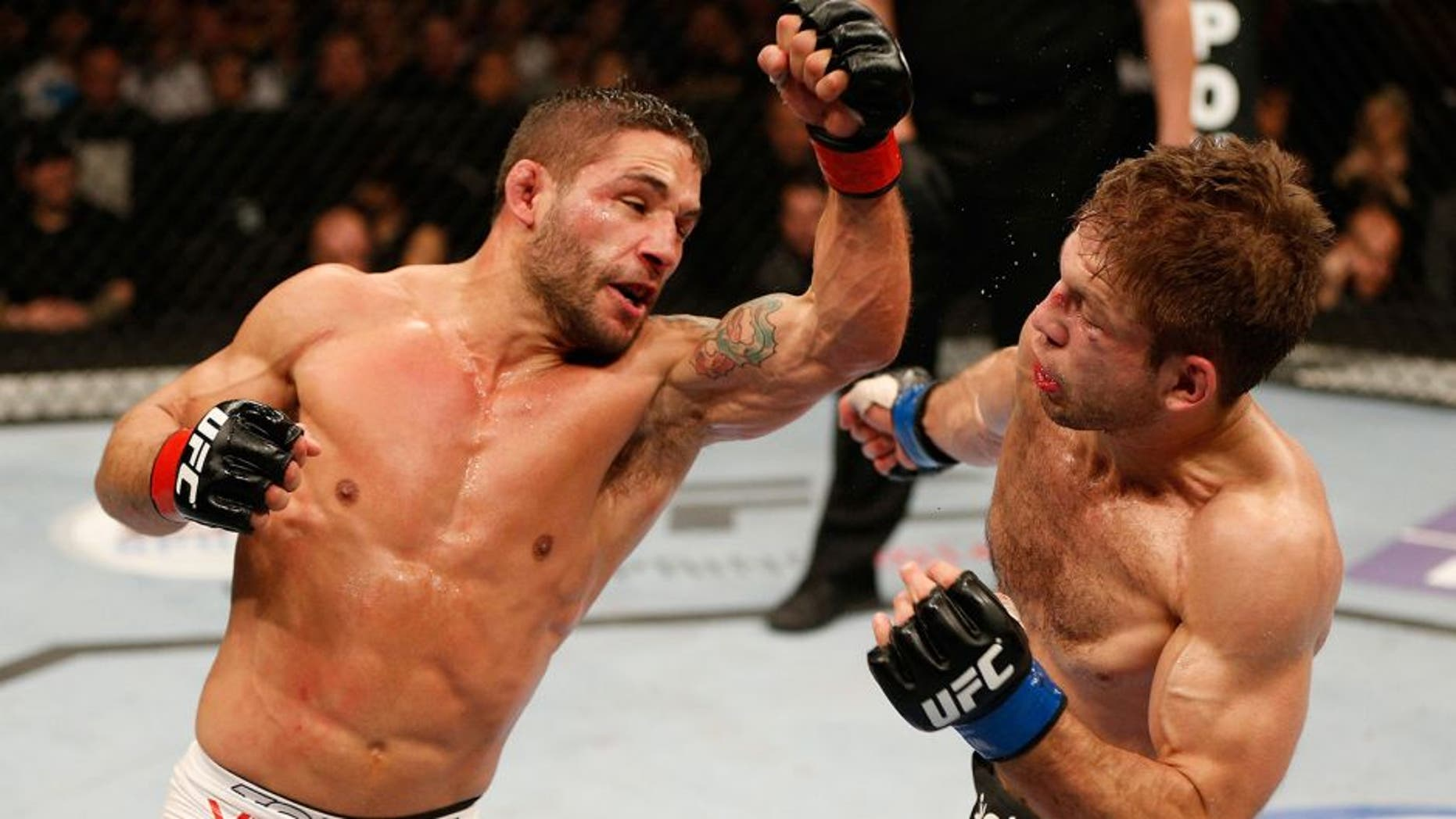 SACRAMENTO, CA - DECEMBER 14: (L-R) Chad Mendes punches Nik Lentz in their featherweight bout during the UFC on FOX event at Sleep Train Arena on December 14, 2013 in Sacramento, California. (Photo by Josh Hedges/Zuffa LLC/Zuffa LLC via Getty Images)