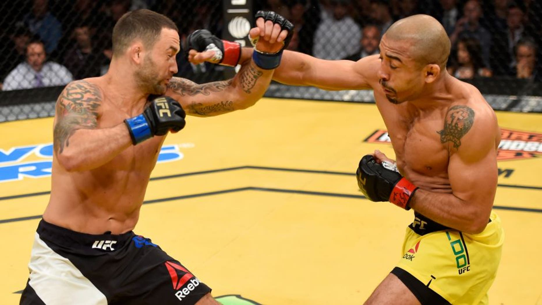 LAS VEGAS, NV - JULY 09: (R-L) Jose Aldo of Brazil punches Frankie Edgar in their UFC interim featherweight championship bout during the UFC 200 event on July 9, 2016 at T-Mobile Arena in Las Vegas, Nevada. (Photo by Josh Hedges/Zuffa LLC/Zuffa LLC via Getty Images)