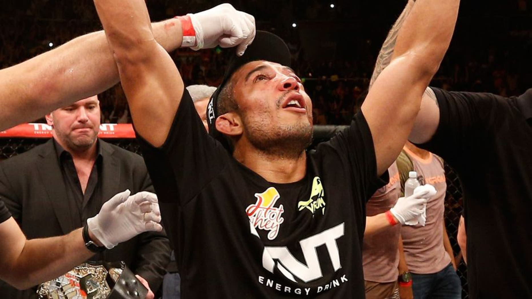 RIO DE JANEIRO, BRAZIL - OCTOBER 25: Jose Aldo of Brazil celebrates after his unanimous-decision victory over Chad Mendes in their featherweight championship bout during the UFC 179 event at Maracanazinho on October 25, 2014 in Rio de Janeiro, Brazil. (Photo by Josh Hedges/Zuffa LLC/Zuffa LLC via Getty Images)