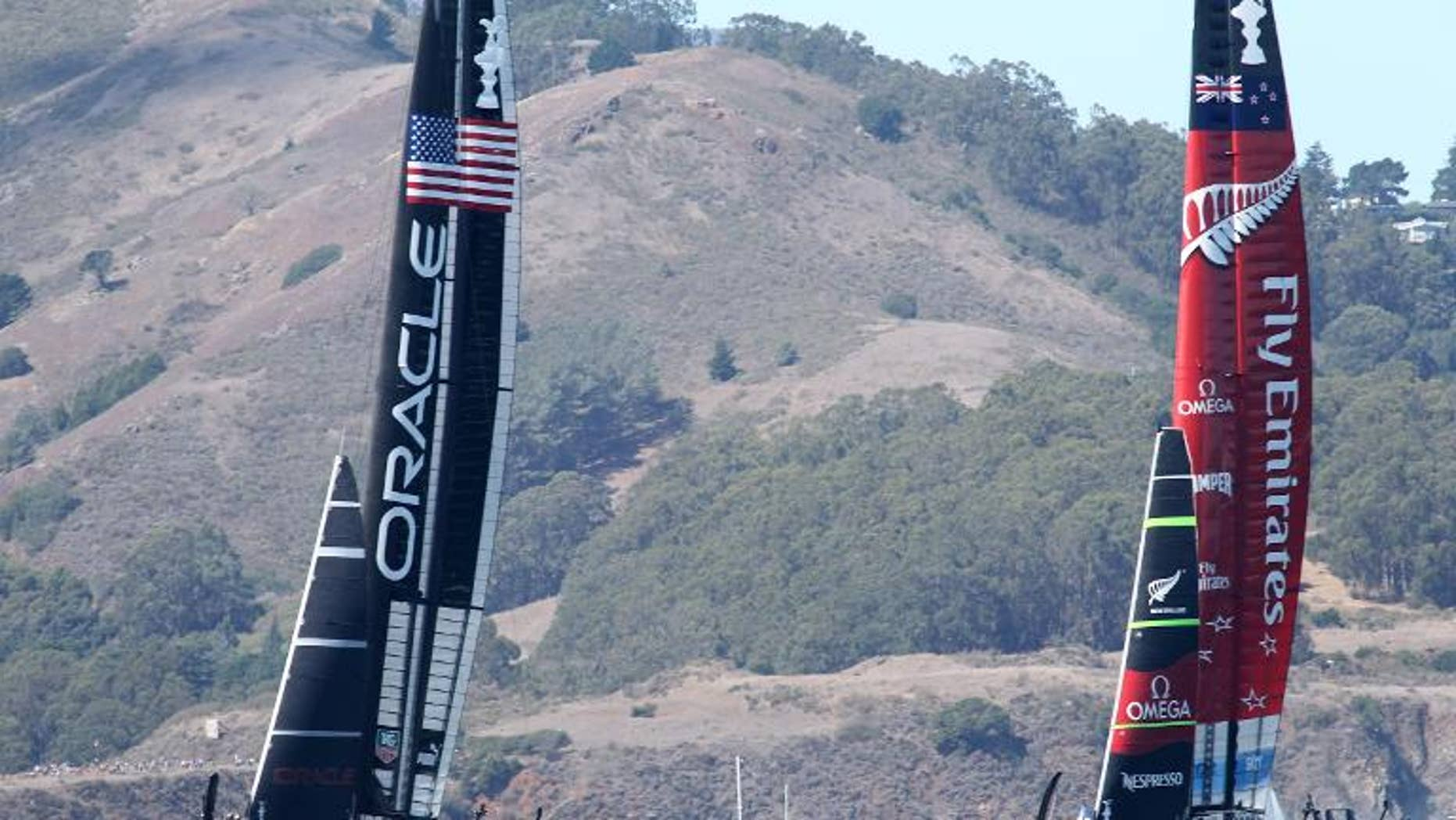 Oracle Team USA and Emirates Team New Zealand start the 19th race of the America's Cup on September 25, 2013, in San Francisco.