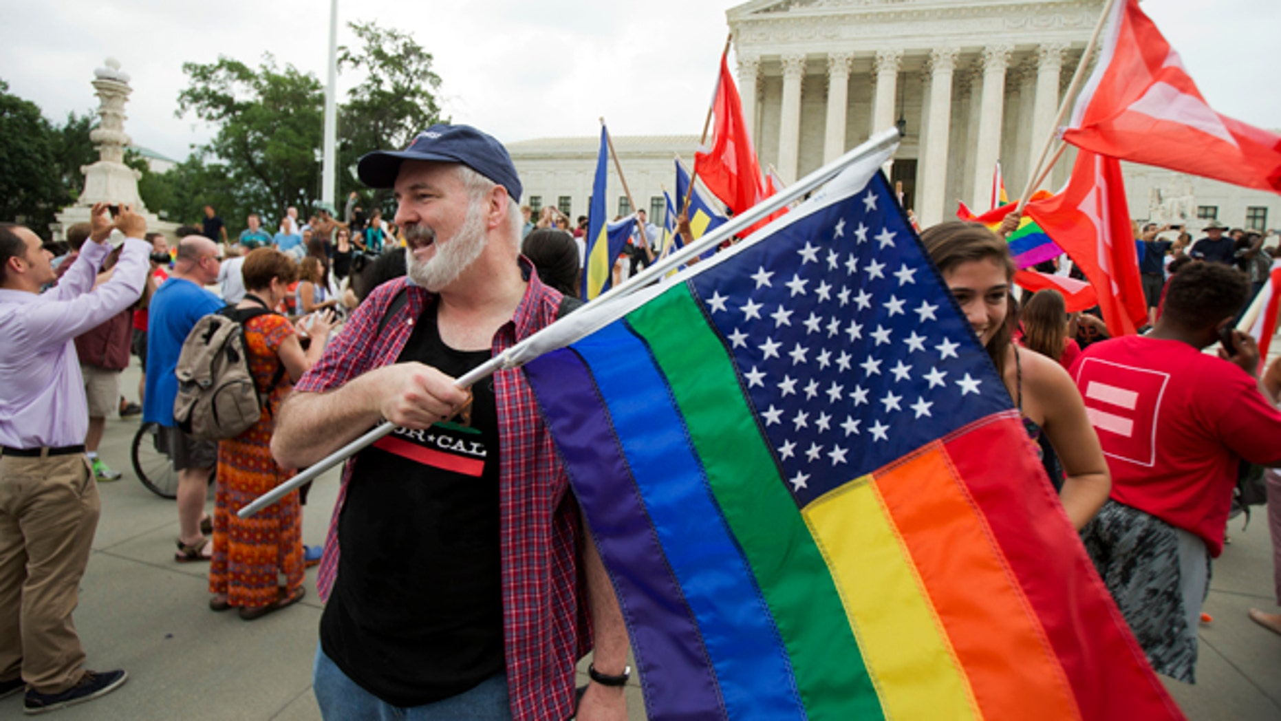 June 26, 2015: Supporters celebrate outside the U.S. Supreme Court in Washington after the court declared that same-sex couples have a right to marry anywhere in the United States.